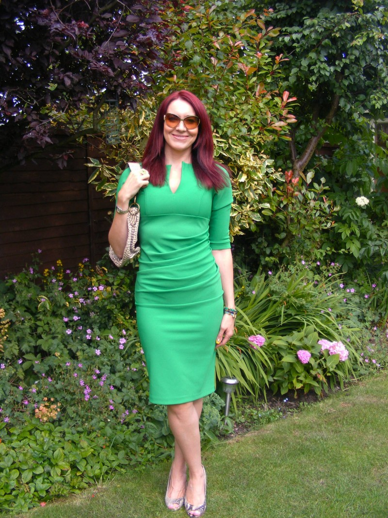 Green fitted Lashes dress