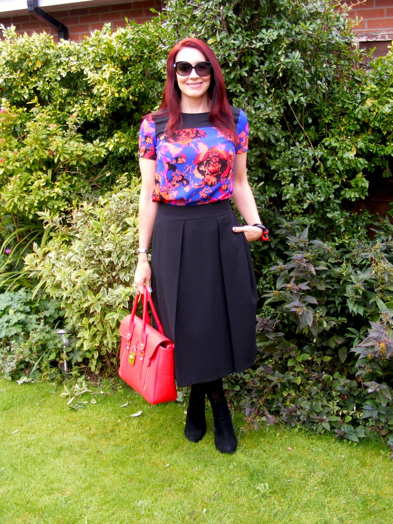 Black midi skirt and Marks and Spencer floral top
