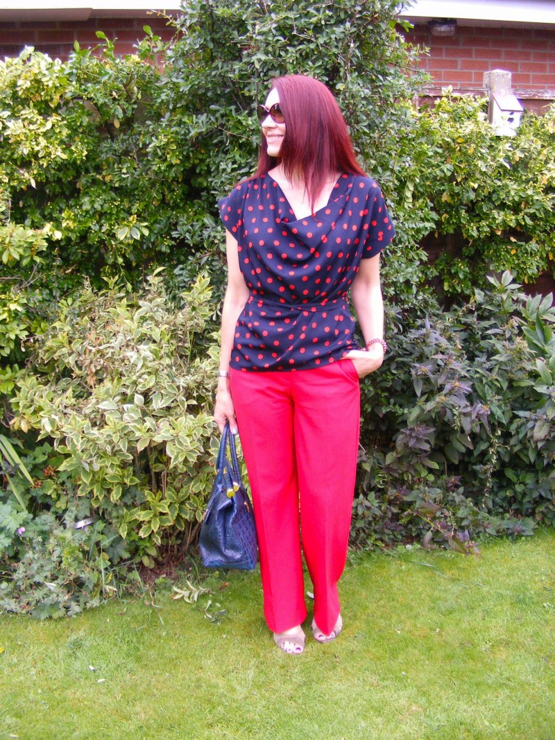 Dorothy Perkins spot top and Oasis red trousers