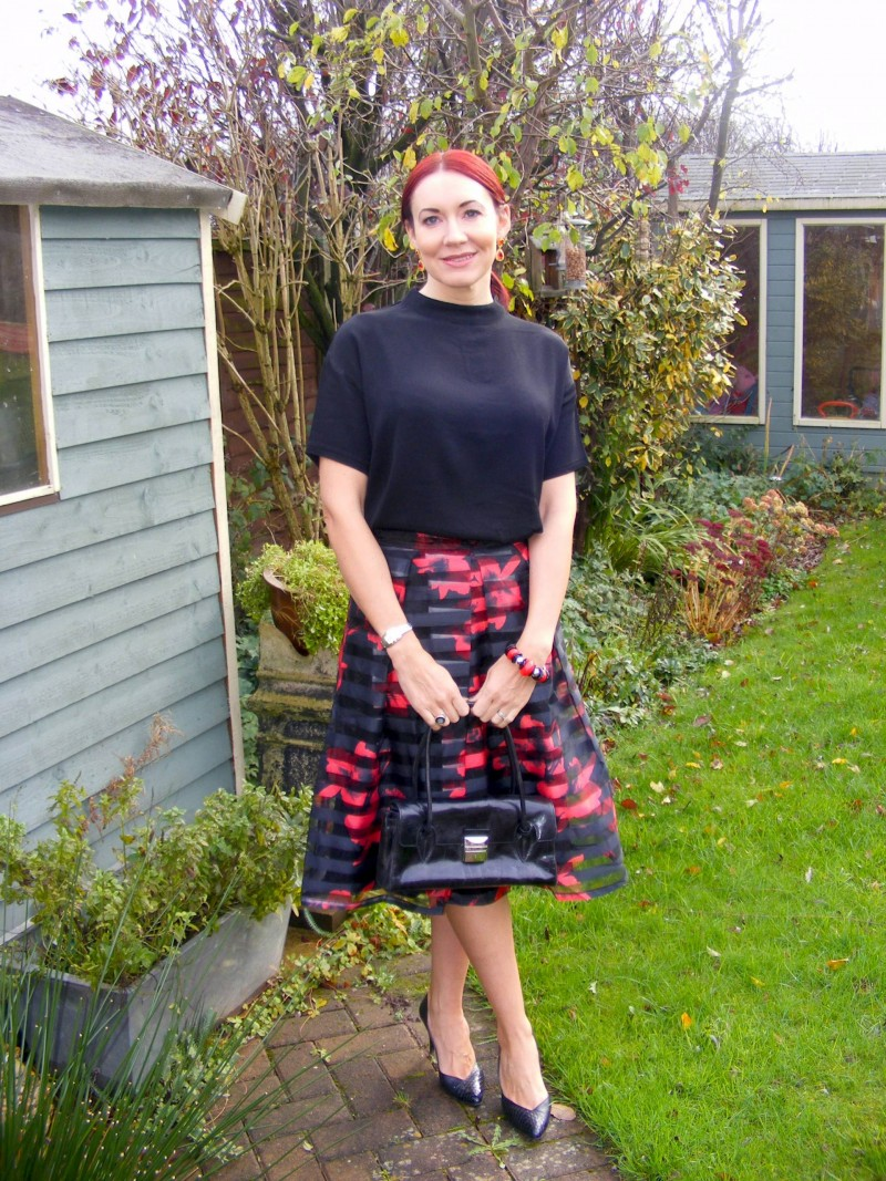 Apricot midi skirt and black top