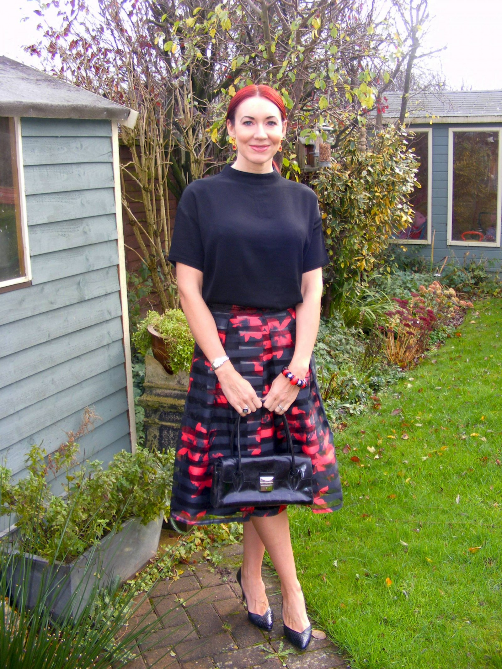 Apricot poppy print skirt and black top