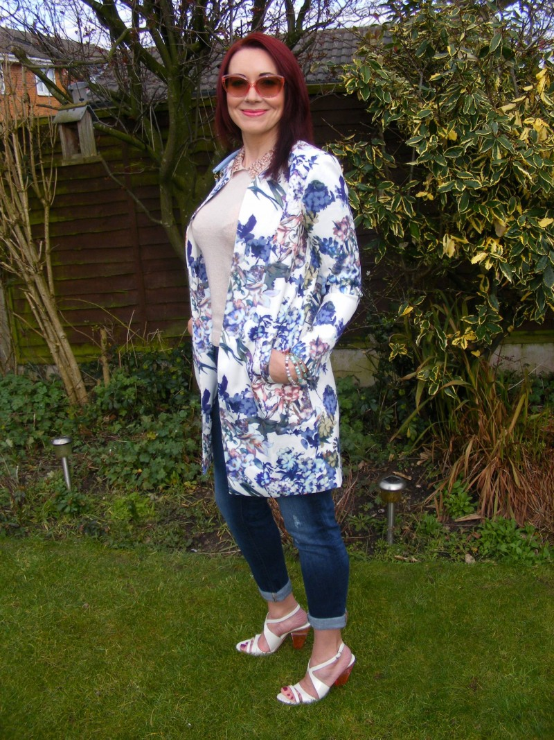 Lorraine for JD Williams floral print coat pale blue Love Moschino handbag