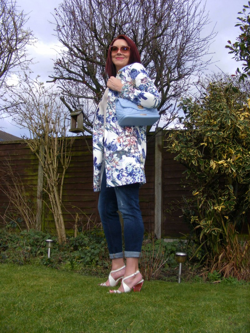 Lorraine for JD Williams floral print coat and pale blue Moschino bag Costume National sandals
