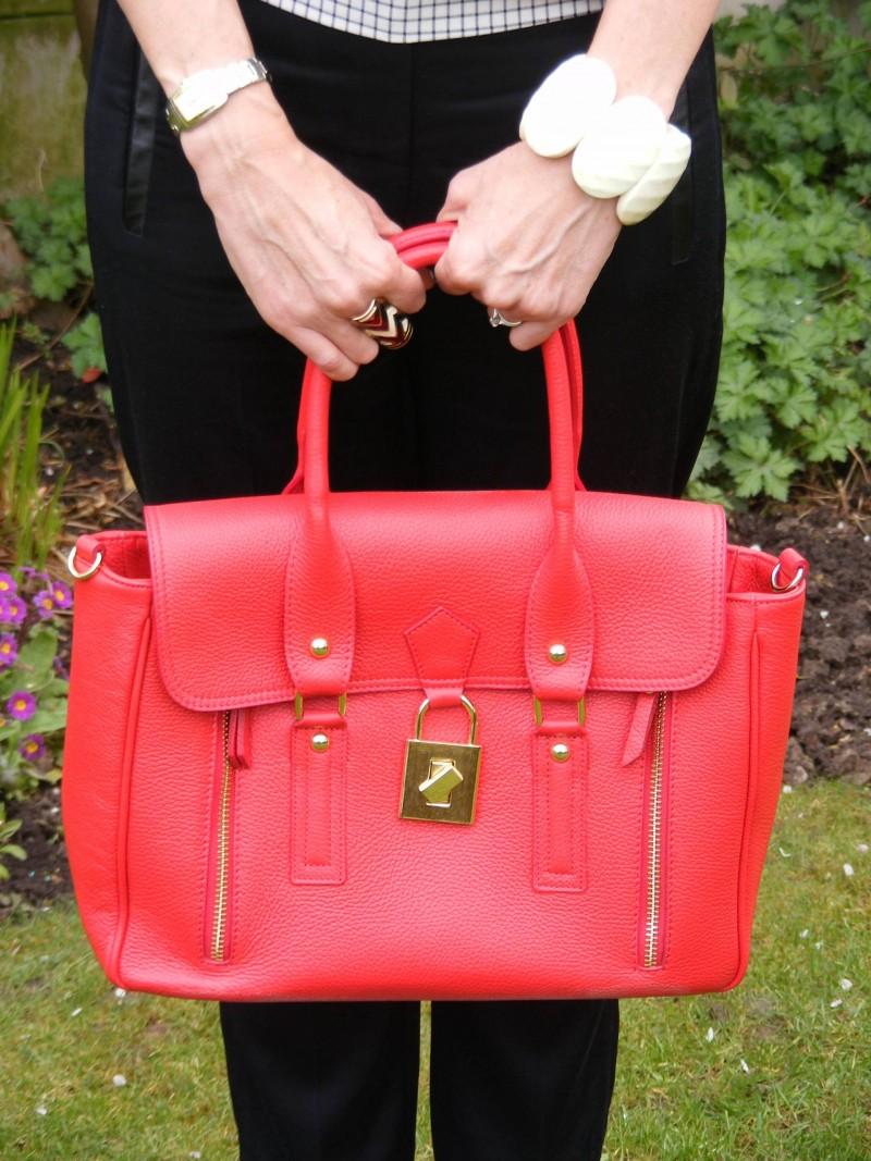 Mila Blu red leather bag black Tibi trousers