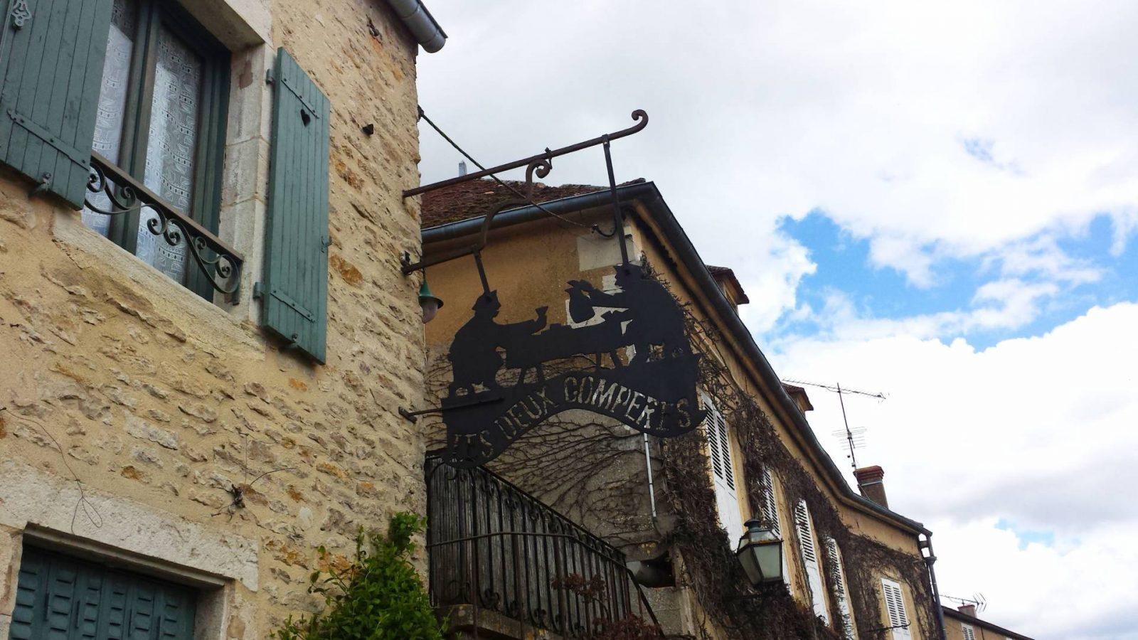 Les Deux Comperes sign Montreal Burgundy