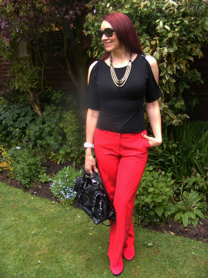 Black cold shoulder top red Oasis trousers