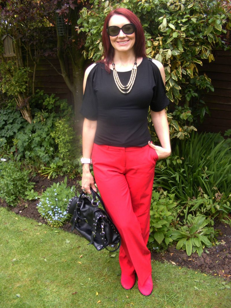 Oasis red trousers cold shoulder top