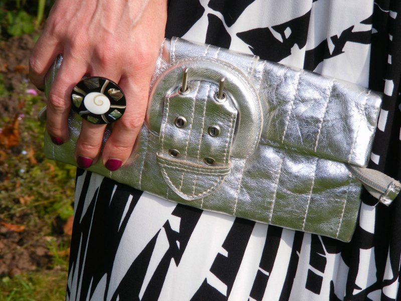 Silver River Island clutch black and white wood ring