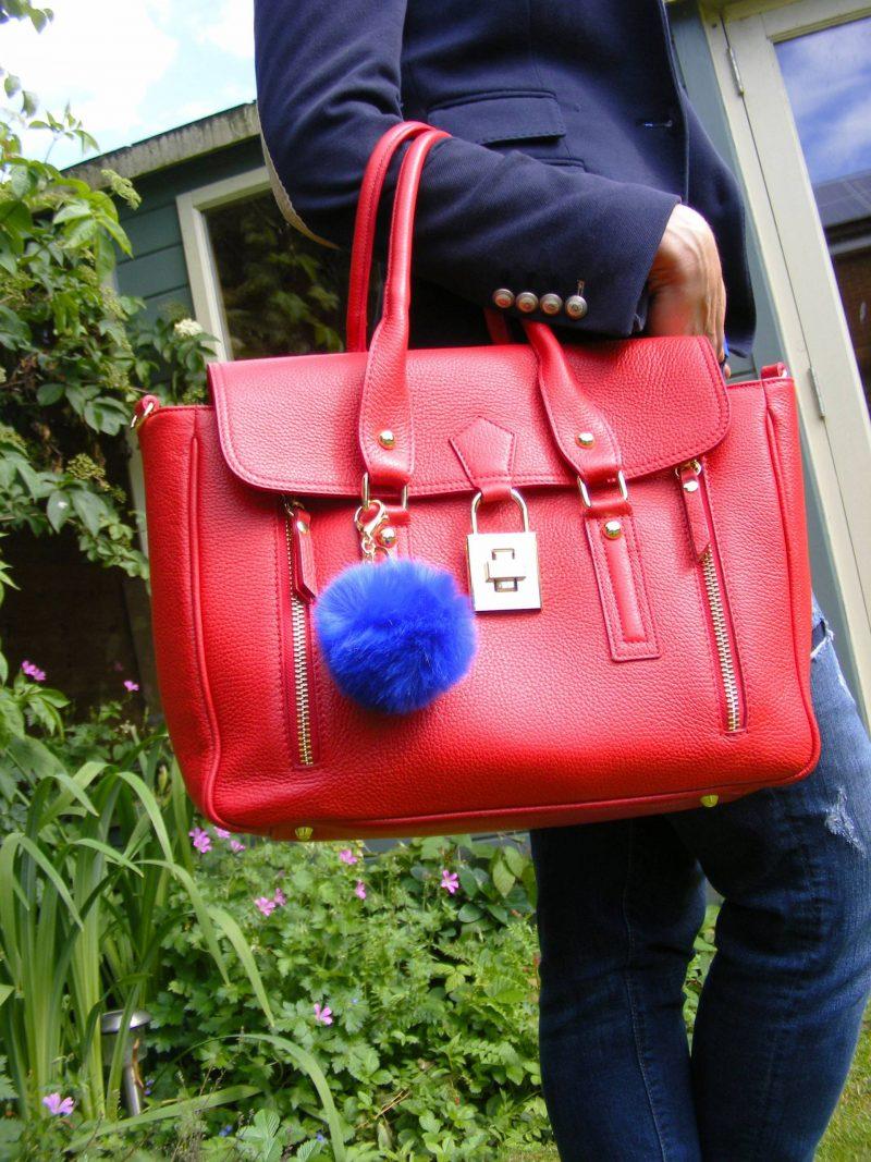 Mila Blu red leather bag blue pompom