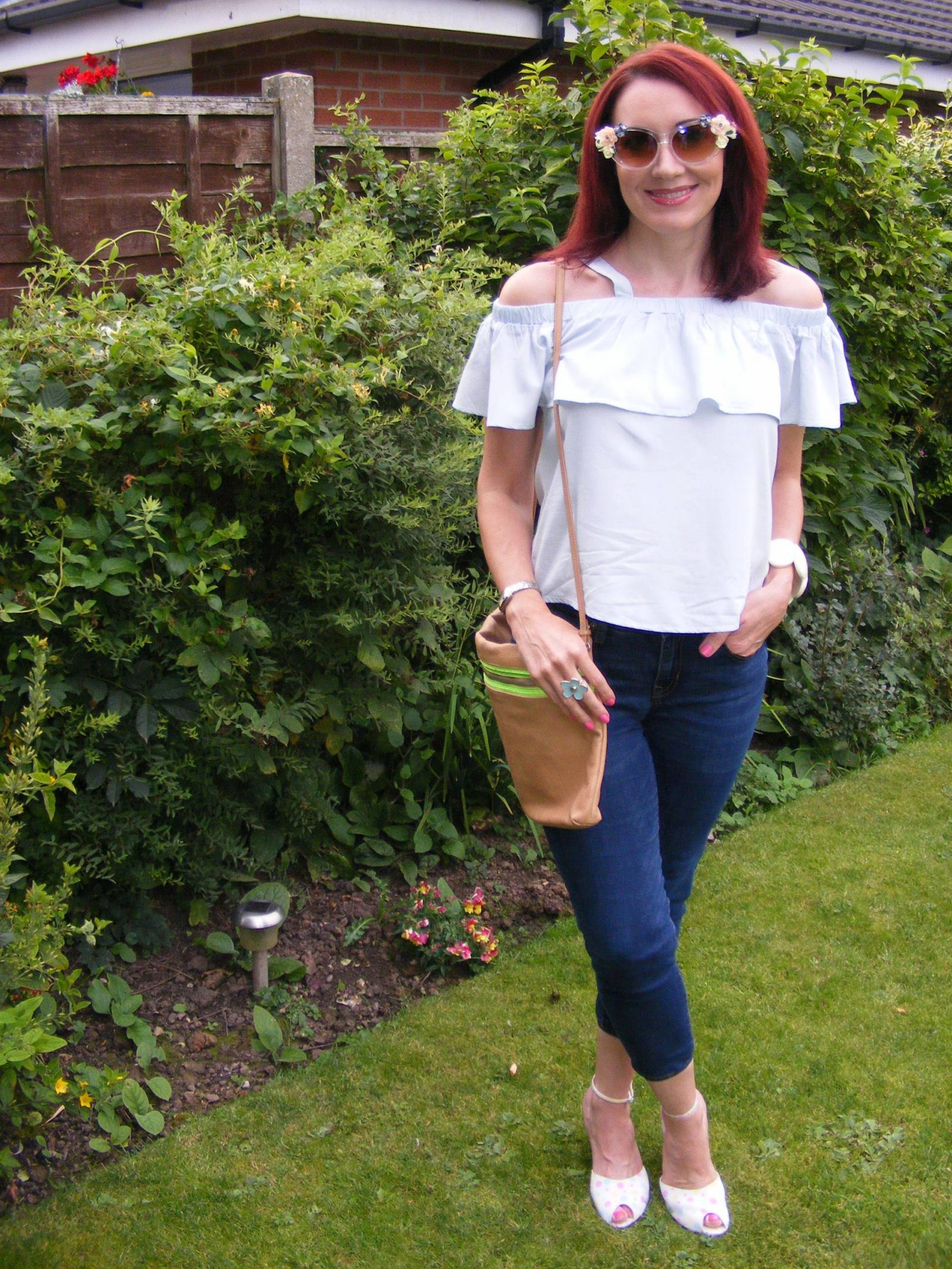 Amy Lynn pale blue off the shoulder top Asos flower sunglasses Gap cropped jeans