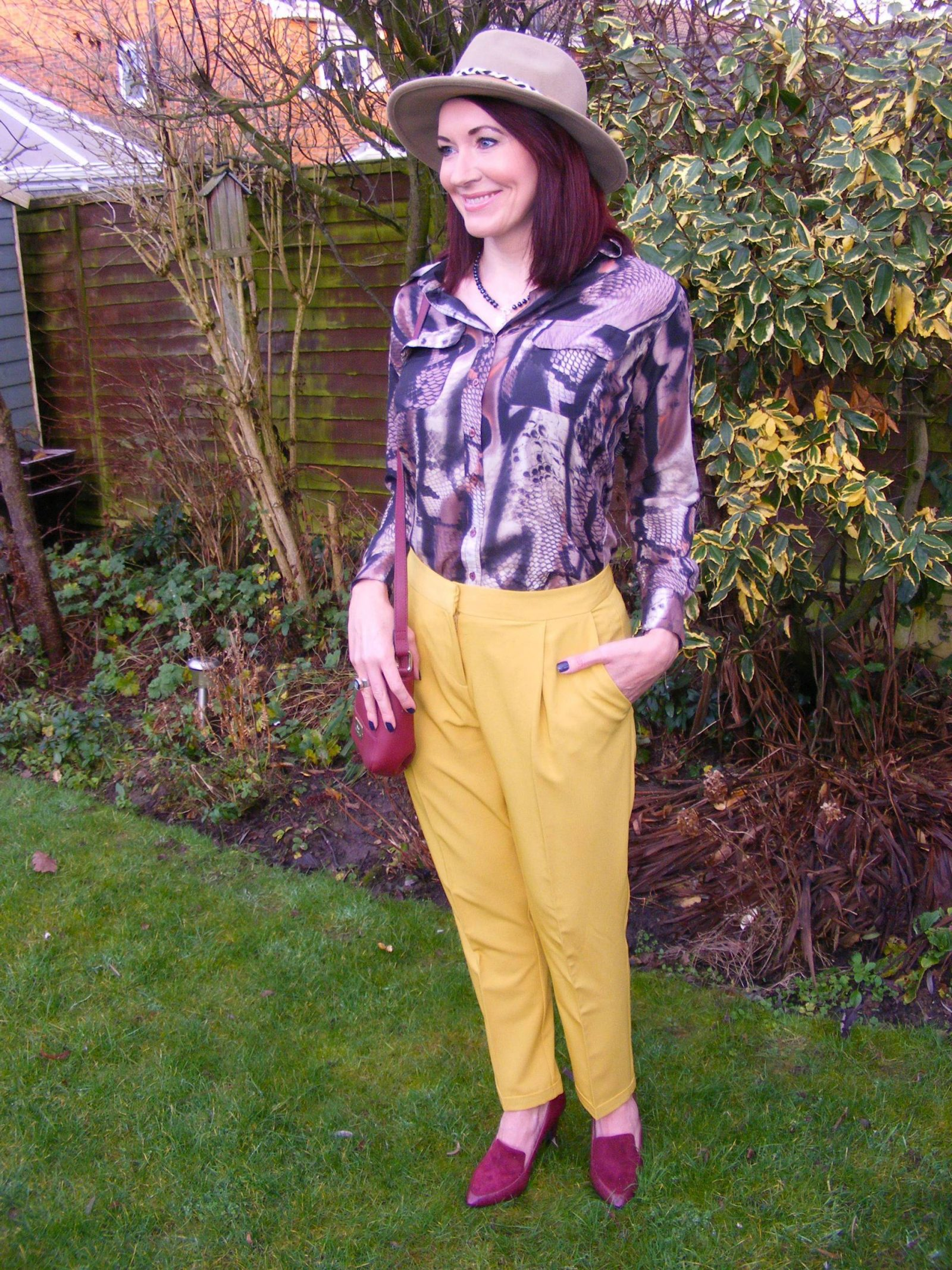 Eternal Collection Aurora crystal necklace Asos mustard trousers Zara hat