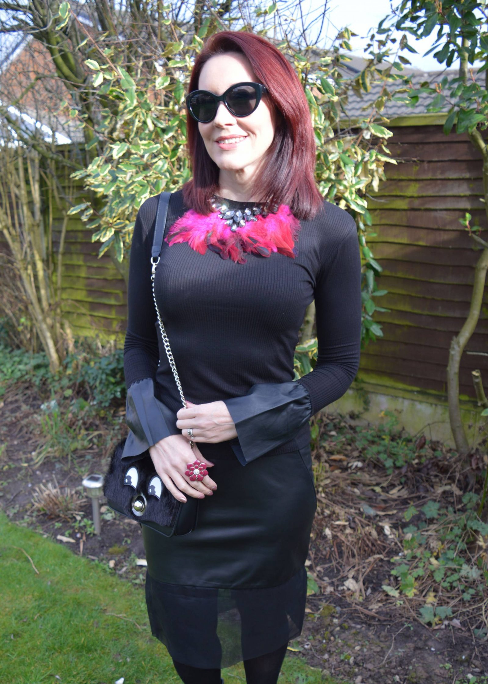 Leather skirt and Statement Sleeves Peridot skirt feather necklace