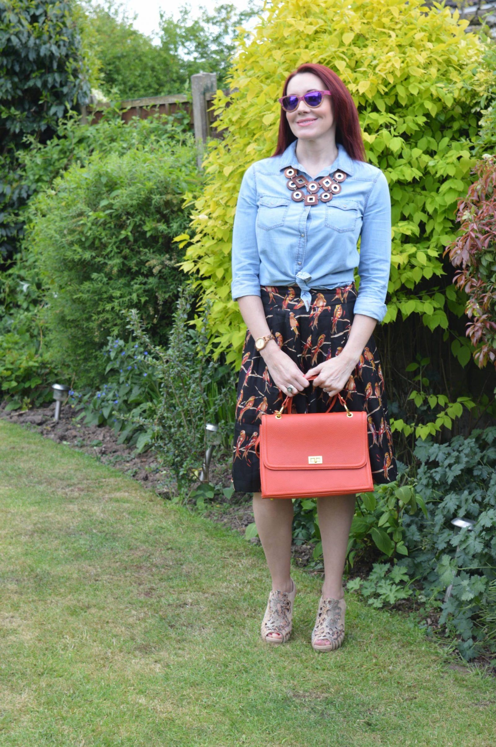 Great Plains bird print skirt, chambray shirt, wooden necklace, Winkwood sunglasses
