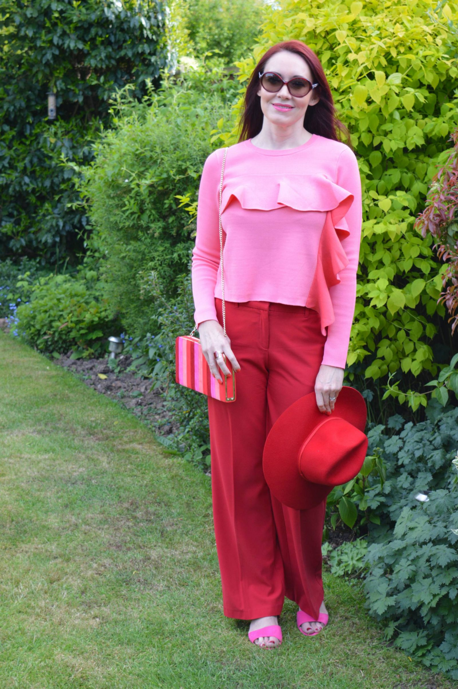 Red trousers, Lotus Shoes, Sheraton microfibre bag Asos pink ruffle jumper