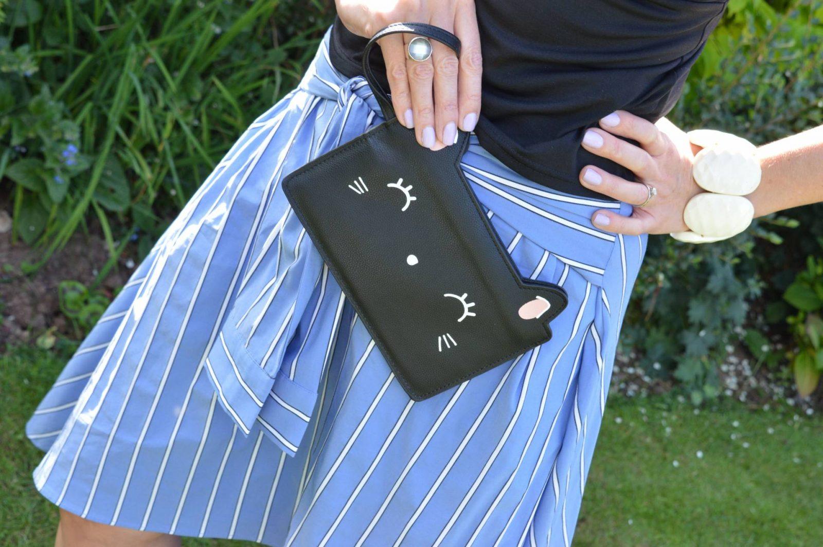 A Skirt With Sleeves Zara midi skirt Prezzybox Kitty clutch