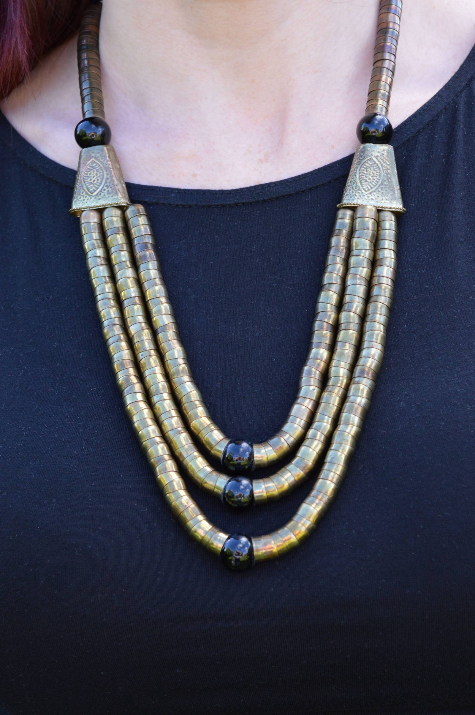 gold and black three strand necklace