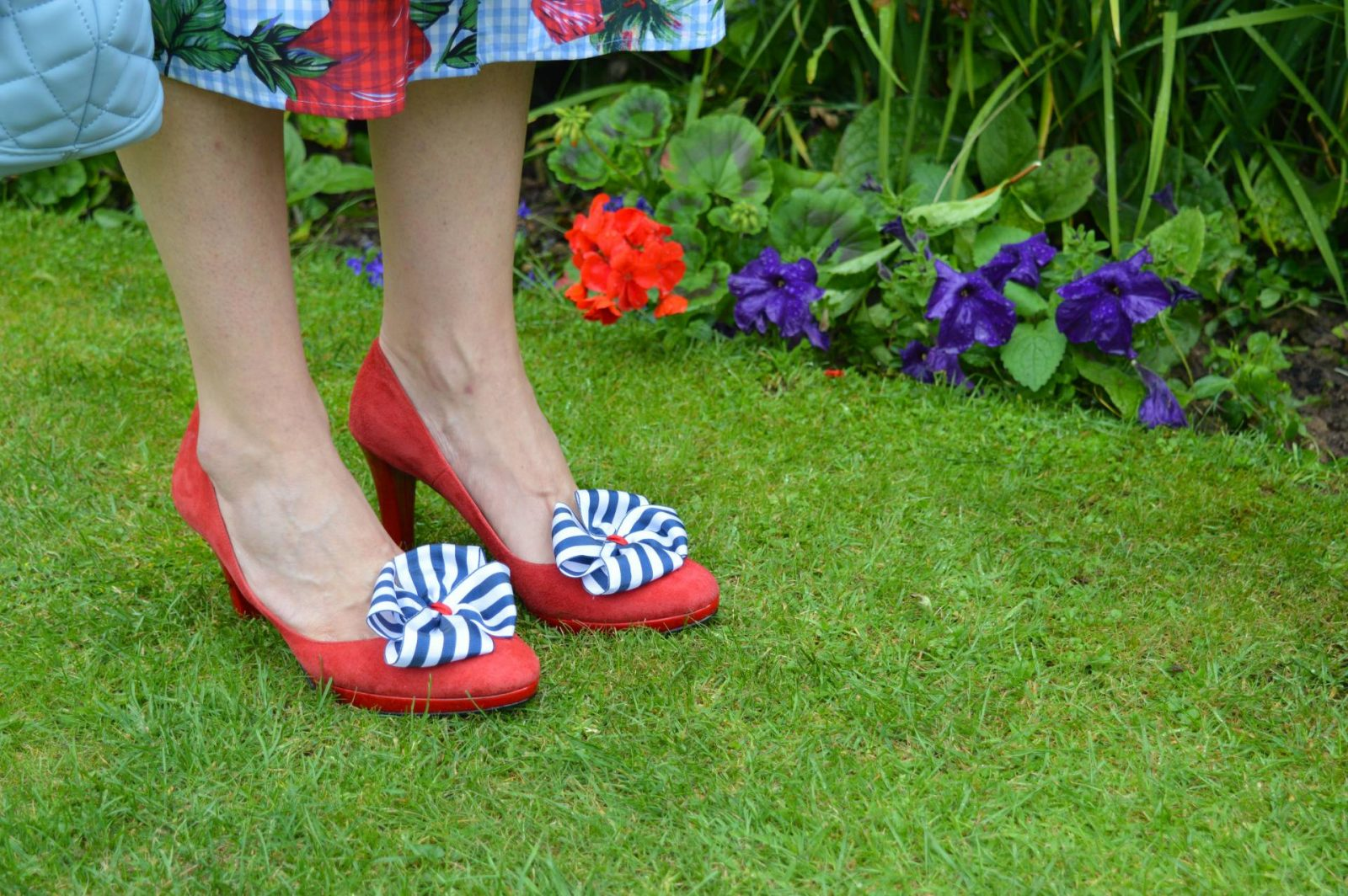 Red shoes with striped shoe clips