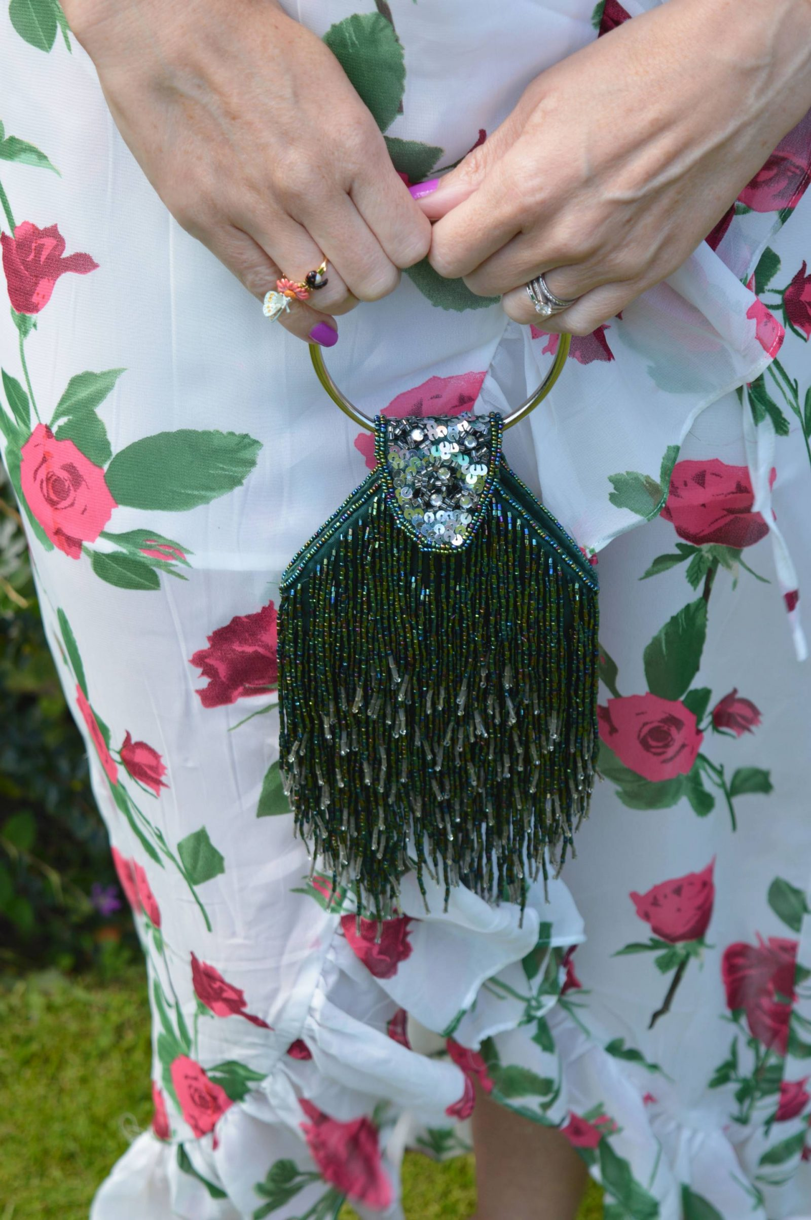 Wedding Guest Dresses From PrettyLittleThing green beaded ring handle bag Les Neriedes butterfly ring