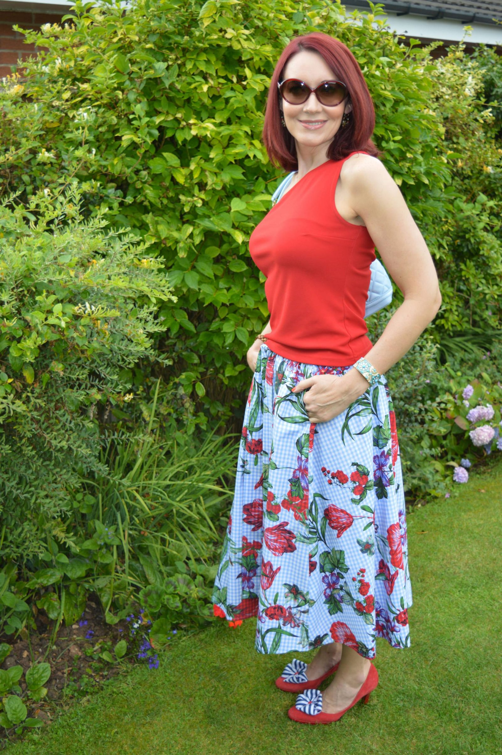 Red asymmetric top, gingham floral print midi skirt