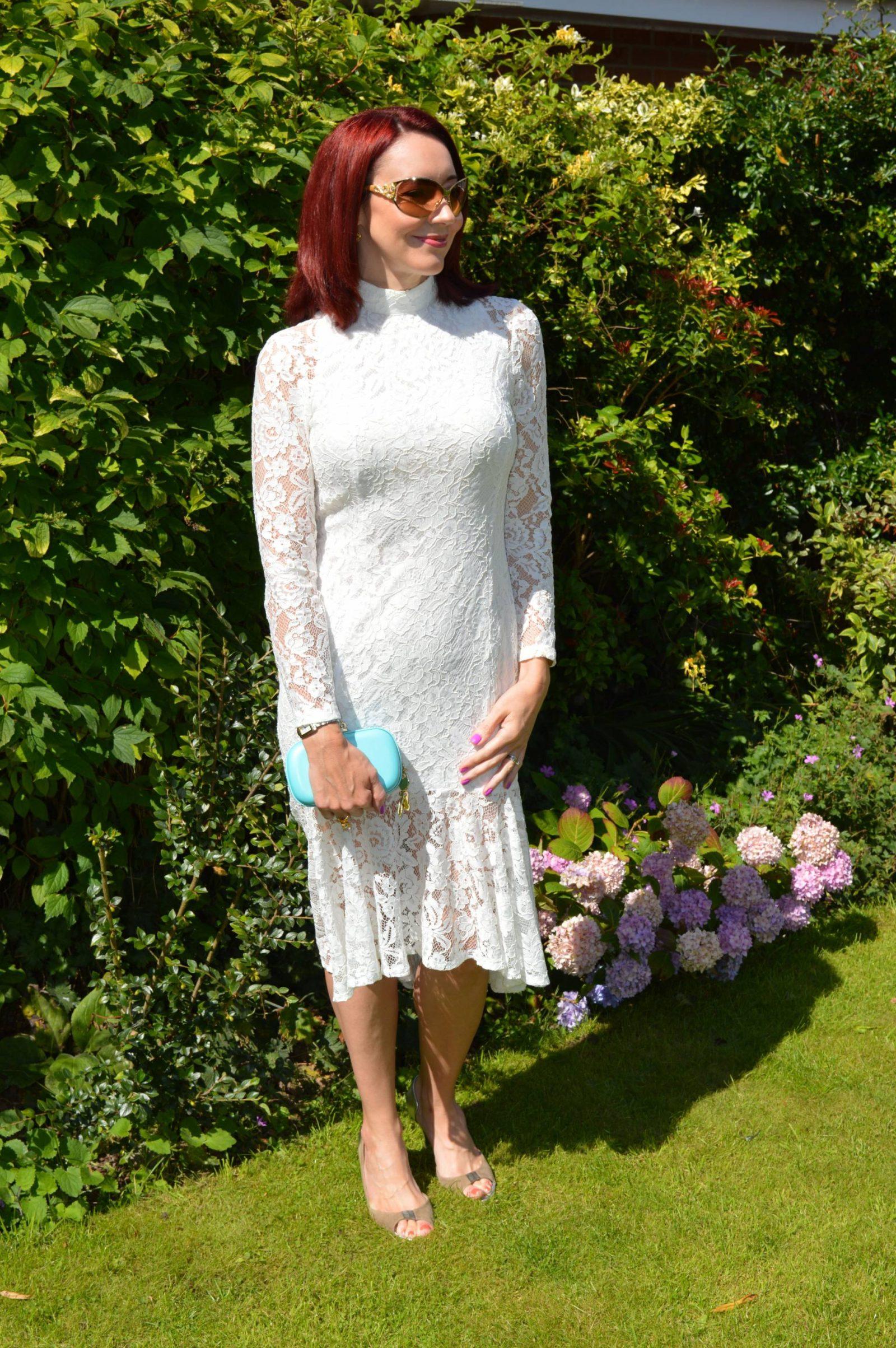 PrettyLittle Thing Ellina white lace fishtail dress Anna Dello Russo H&M clutch bag