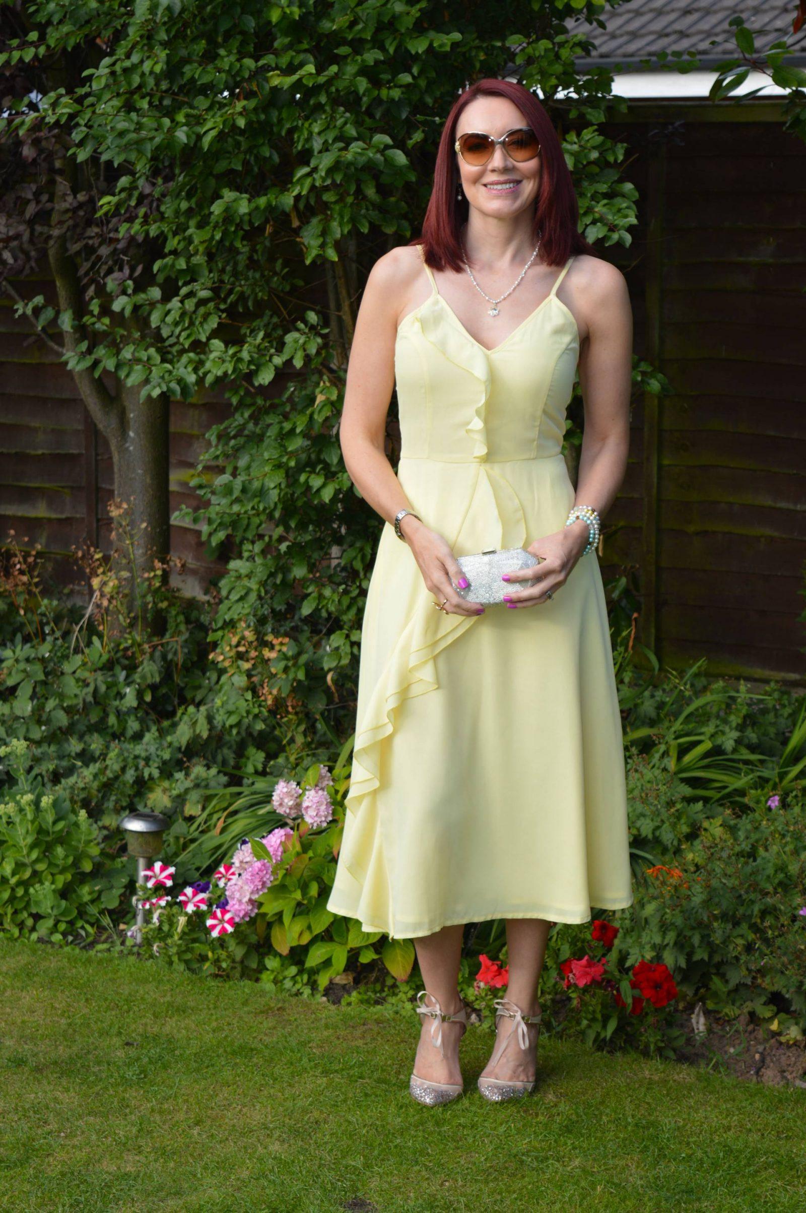 Wedding Guest Dresses From PrettyLittleThing Dallia lemon ruffle dress