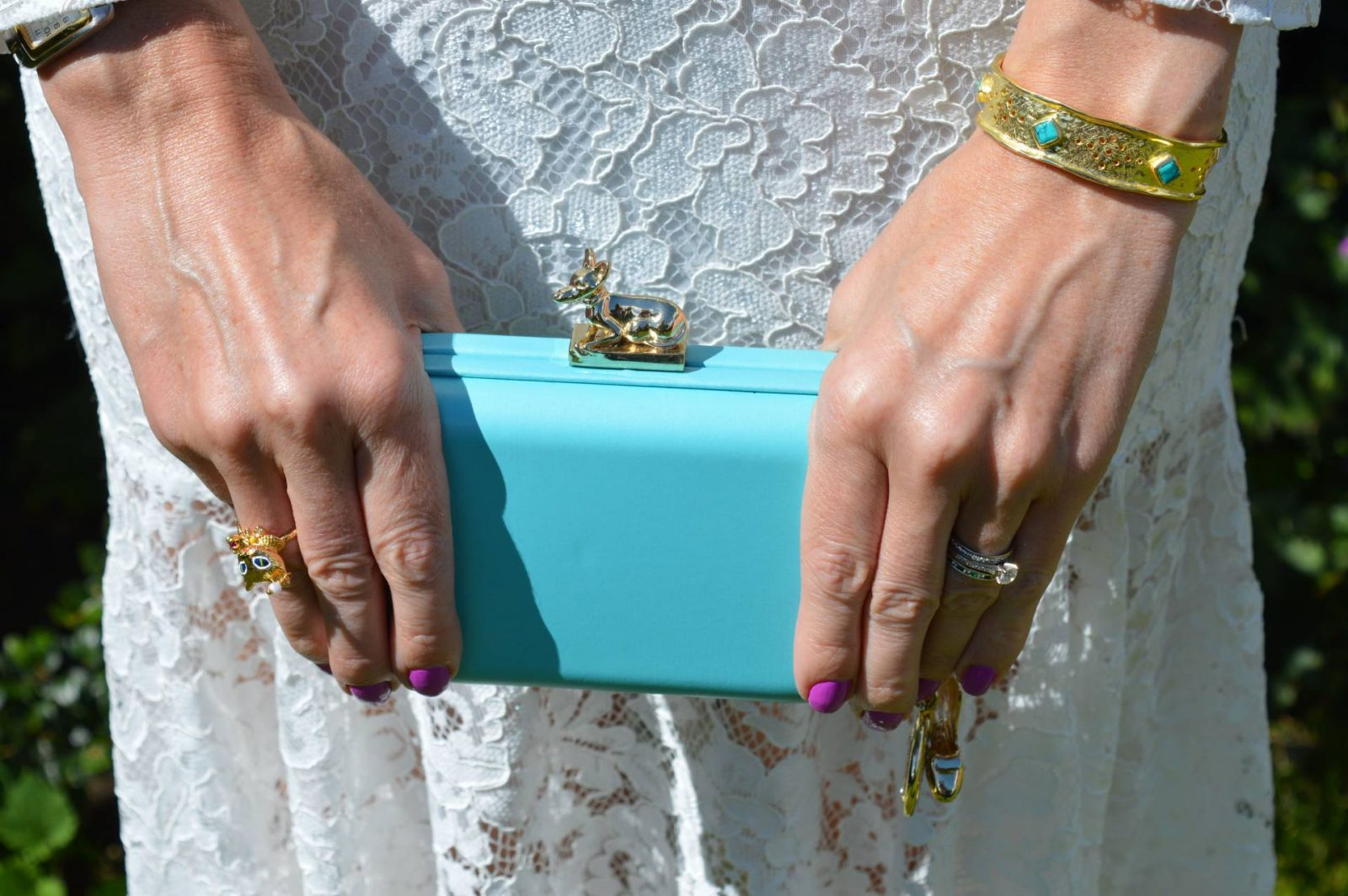 Wedding Guest Dresses From PrettyLittleThing white lace dress, Anna Dello Russo for H&M turquoise clutch Azuni cuff