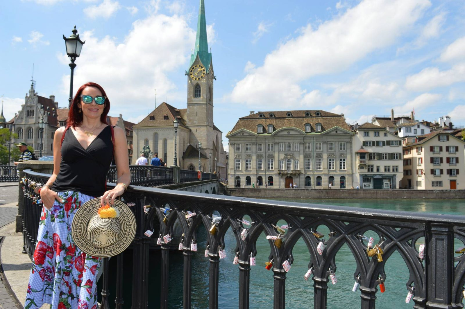 A Comfortable, Chic Outfit For a Day Sightseeing in Zurich Zara gingham floral print skirt Amevie sunglasses, Mango straw hat
