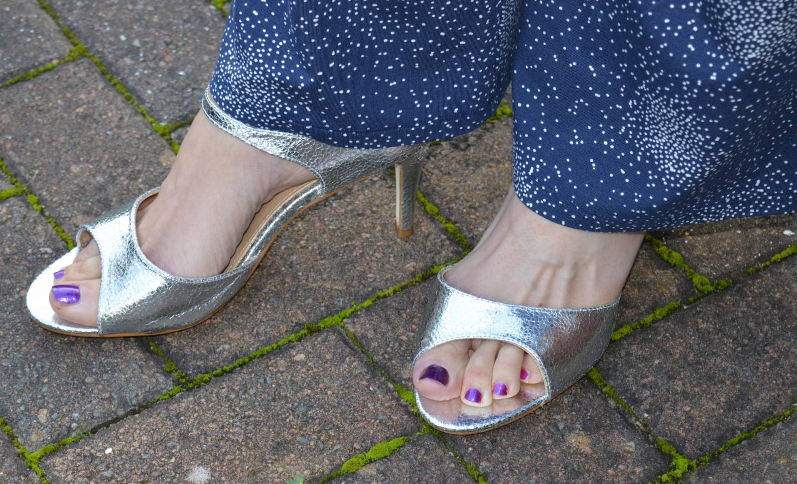 Styling a jumpsuit for day to night Laura Ashley navy jumpsuit matalan silver sandals
