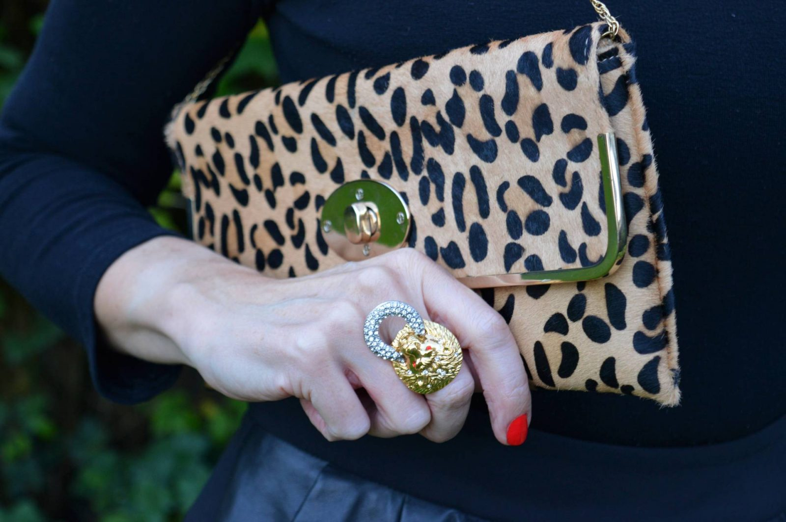 leopard print clutch bag Kenneth Jay Lane lion ring