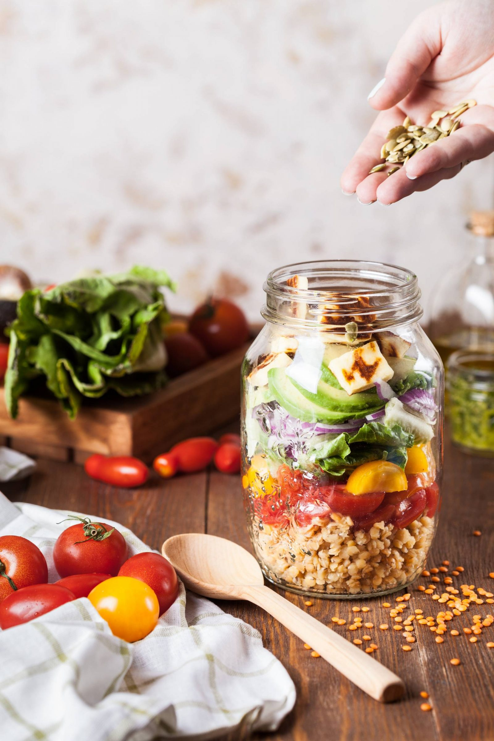 Six months of being vegan, glass jar filled with salad and seeds