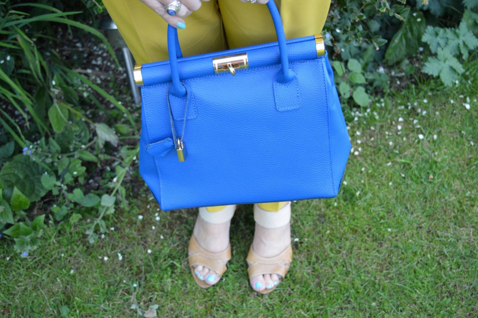 Mustard trousers and cobalt tote bag