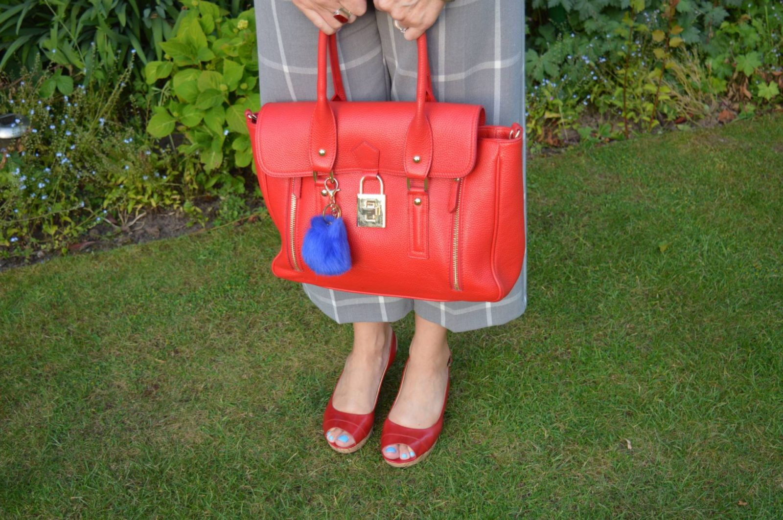 Red Mila Blu bag and cropped grey trousers