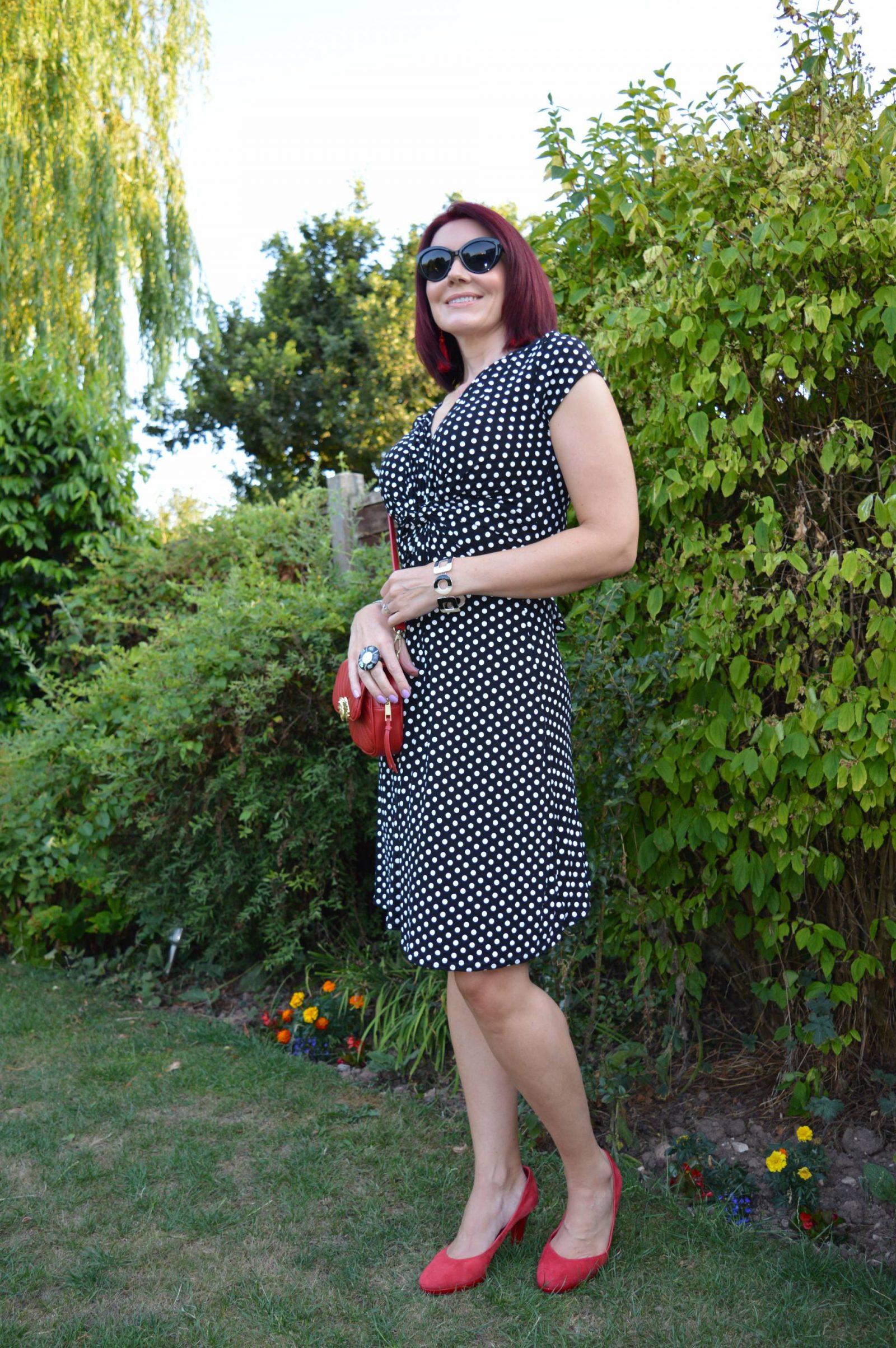 Krisp Black and white polka dot dress with red accessories