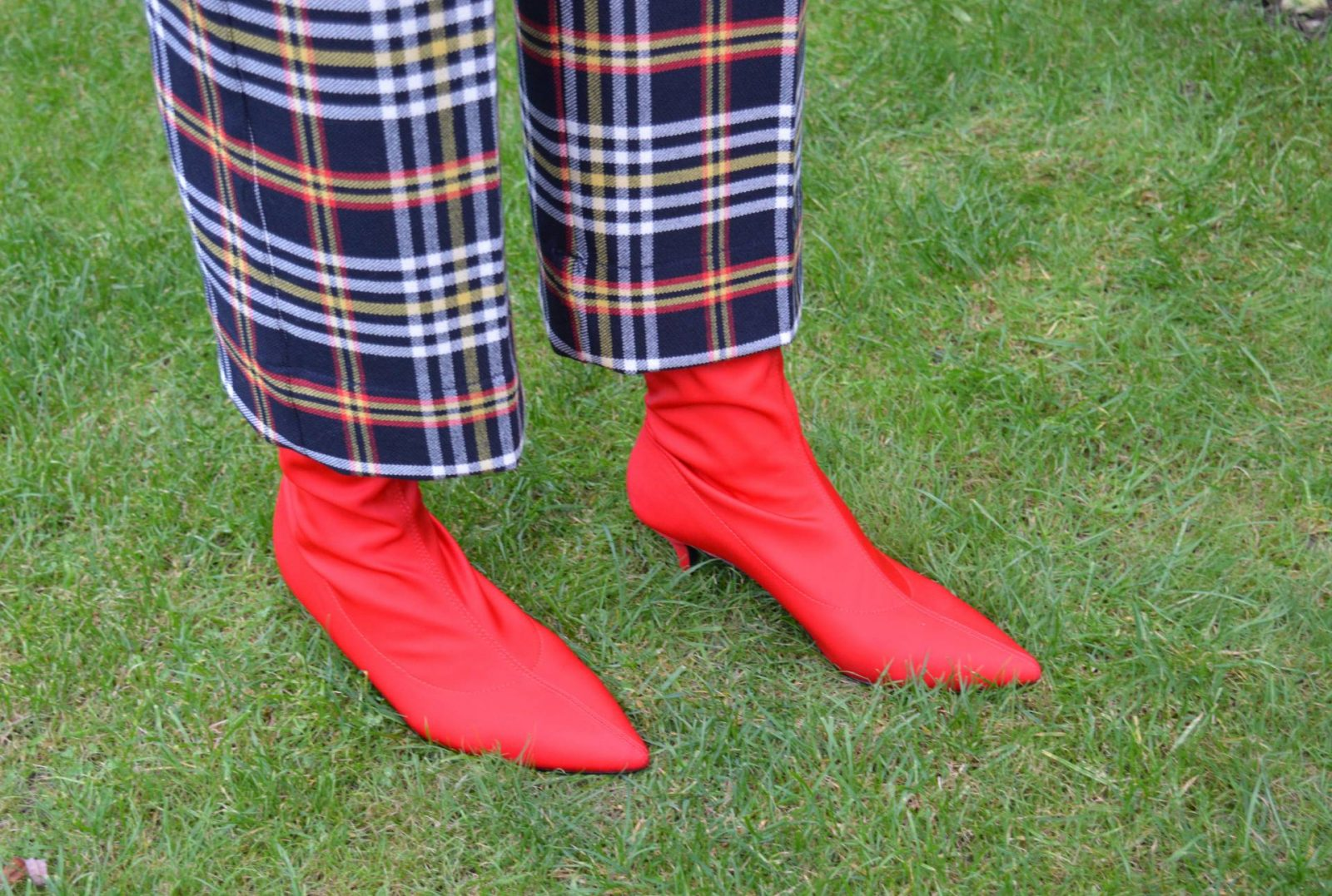 Embracing the new season in tartan trousers and a turtleneck sweater, Zara cropped tartan trousers, red sock boots
