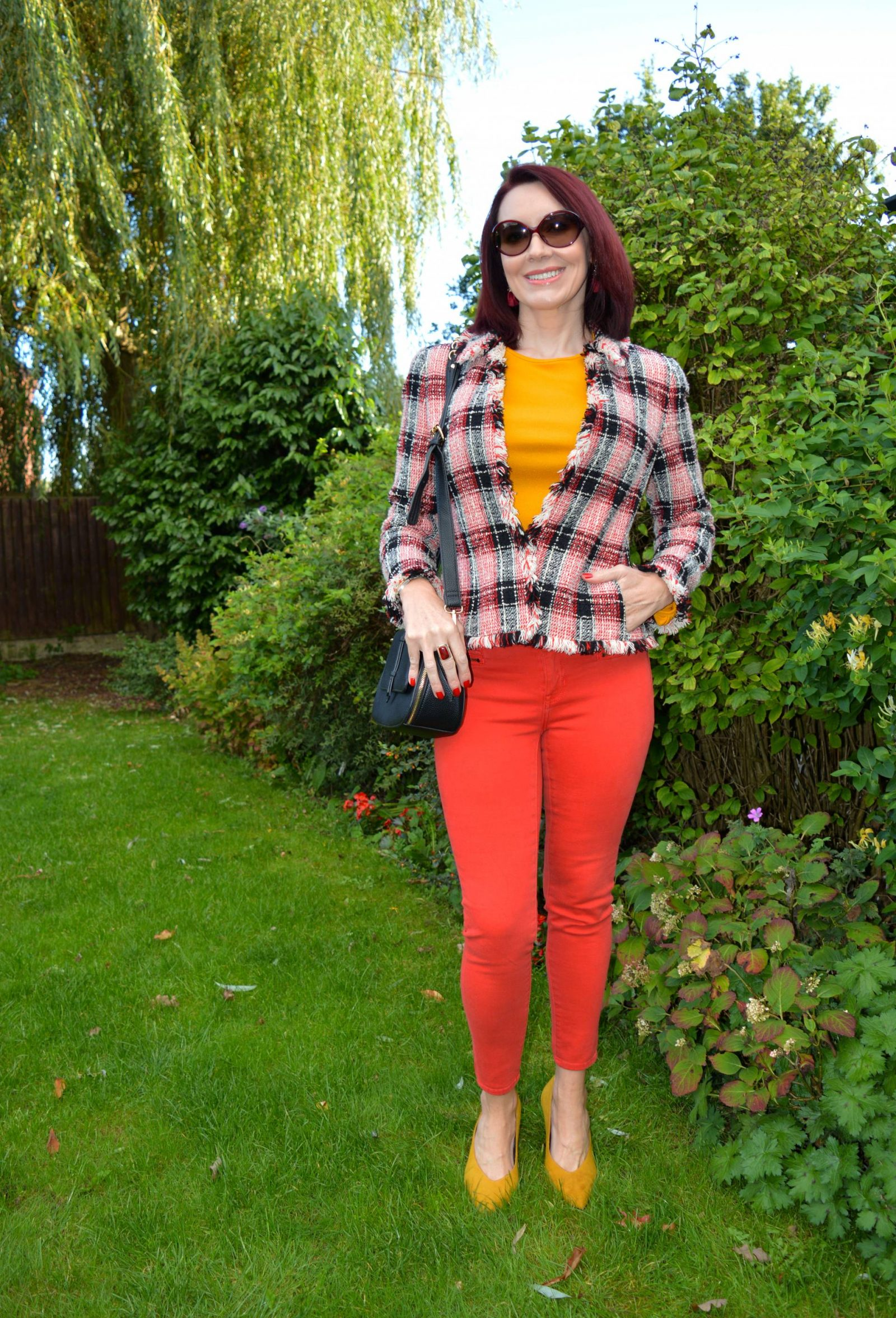 Red jeans, check jacket and a hint of mustard