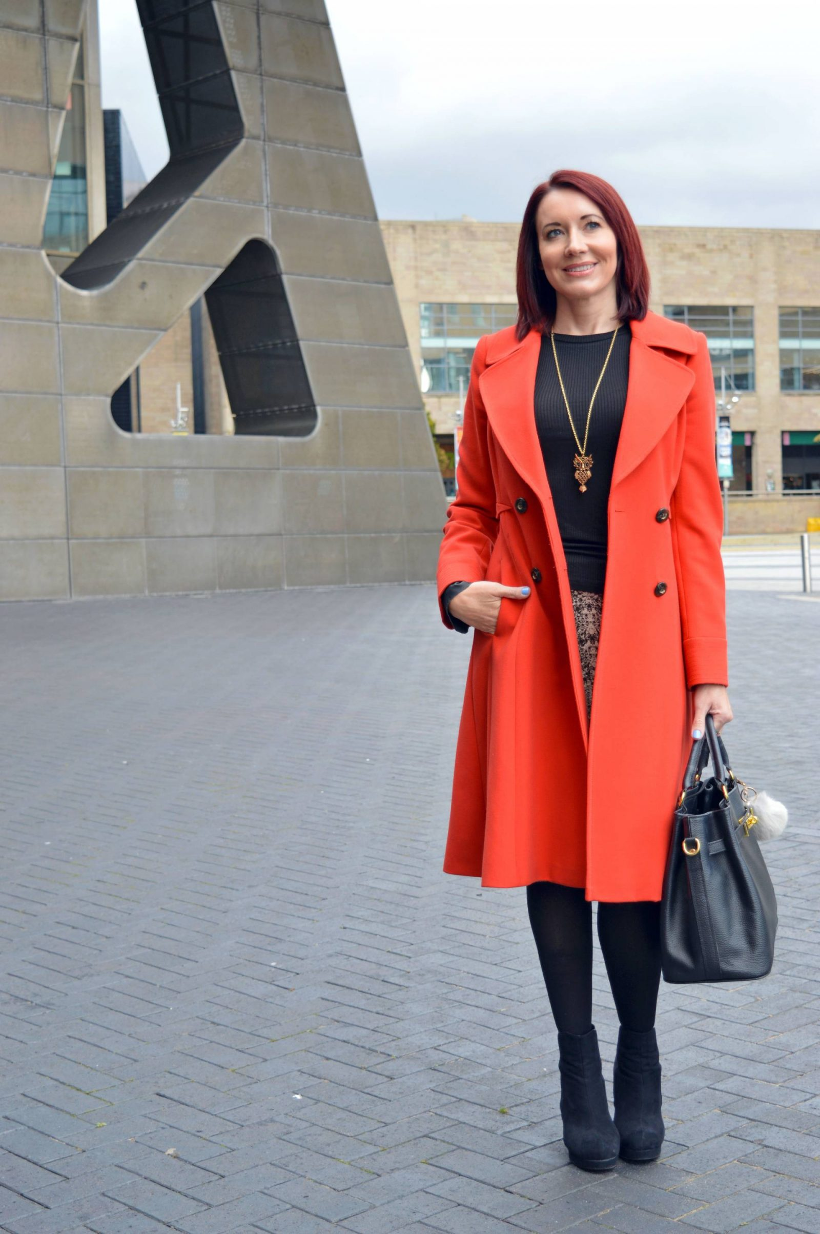 Snake print skirt, statement sleeves and red coat
