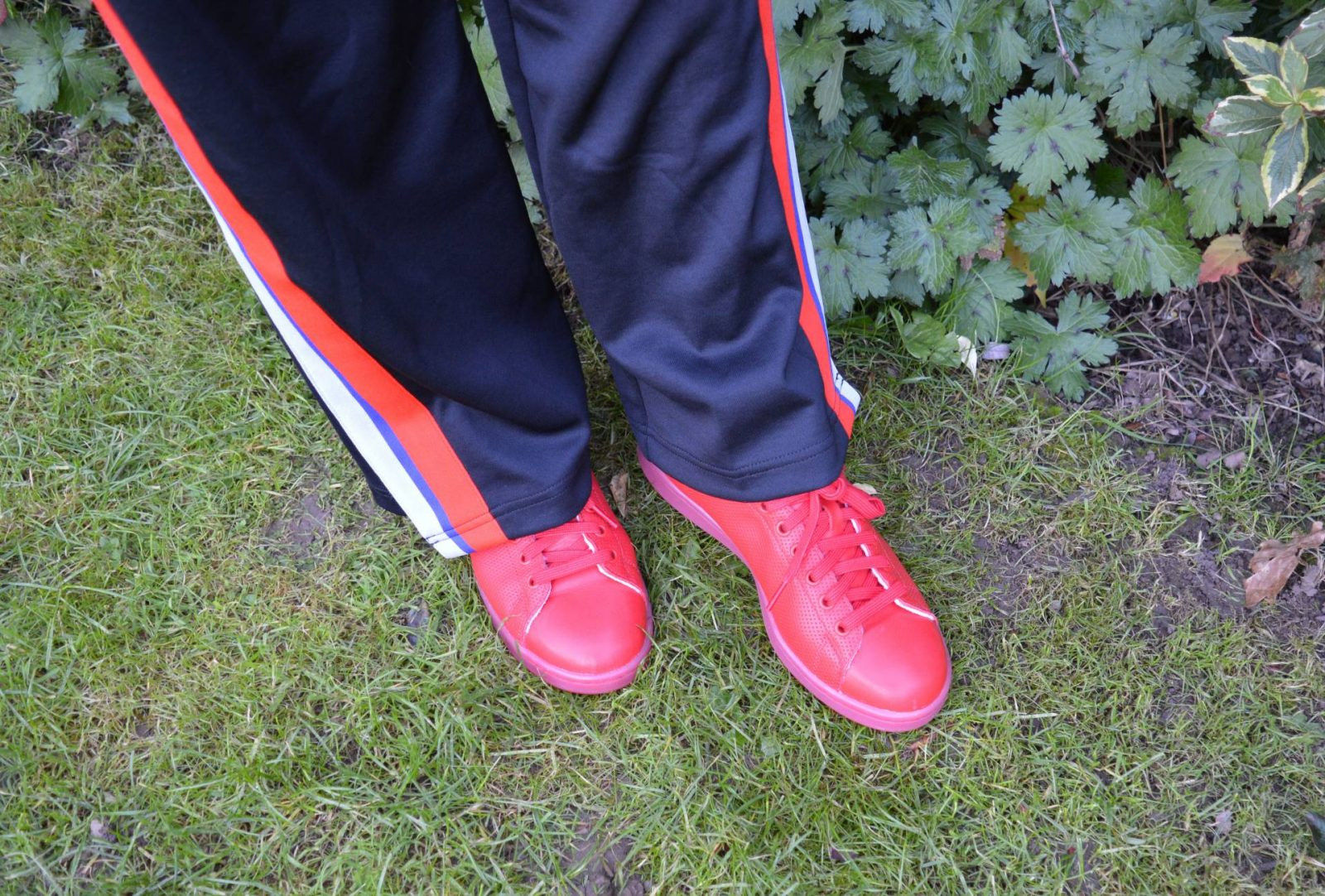 Dressing for comfort in athleisure, red Adidas Stan Smiths