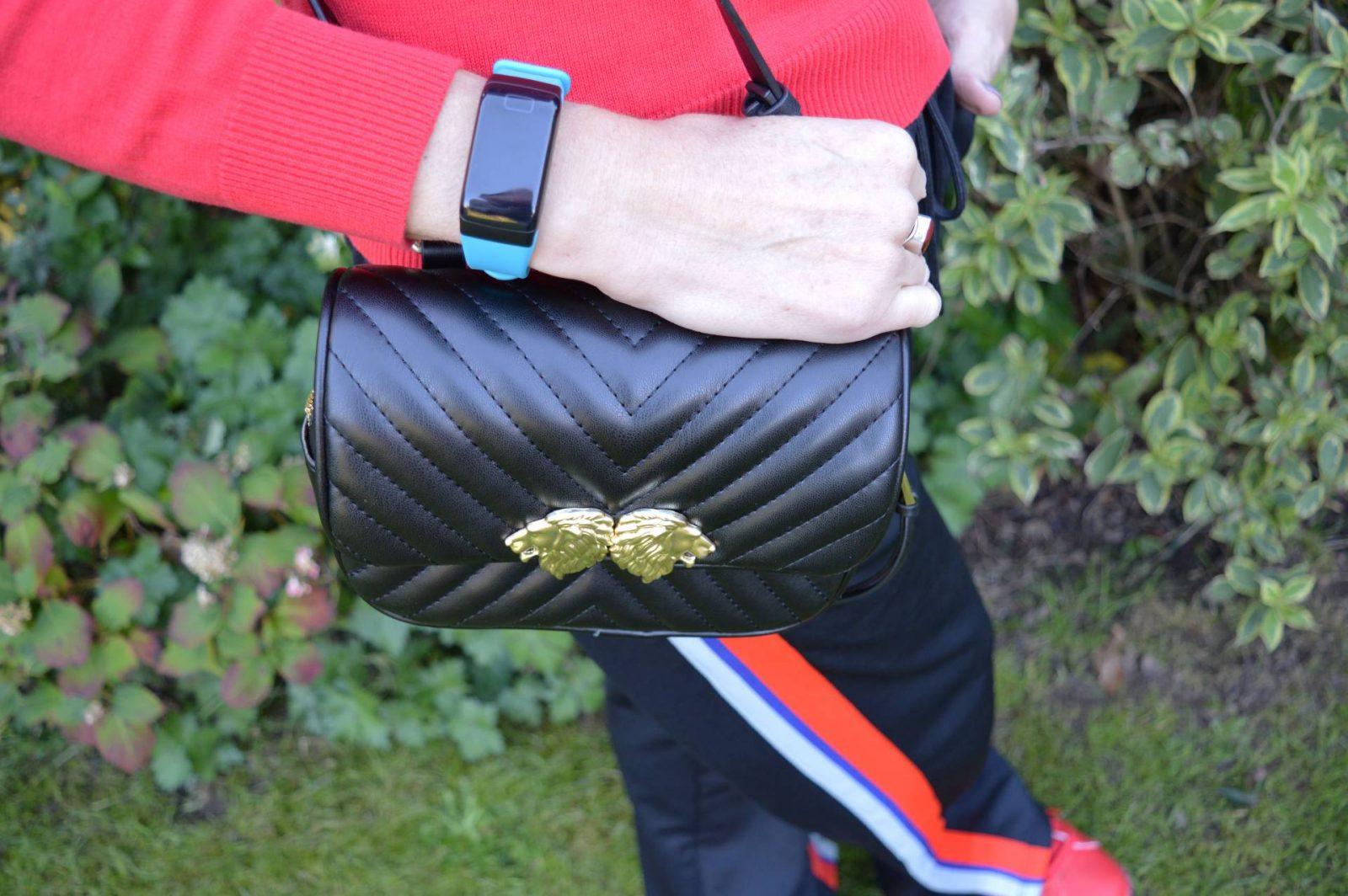Dressing for comfort in athleisure, black Zara beltbag, FourFit health band