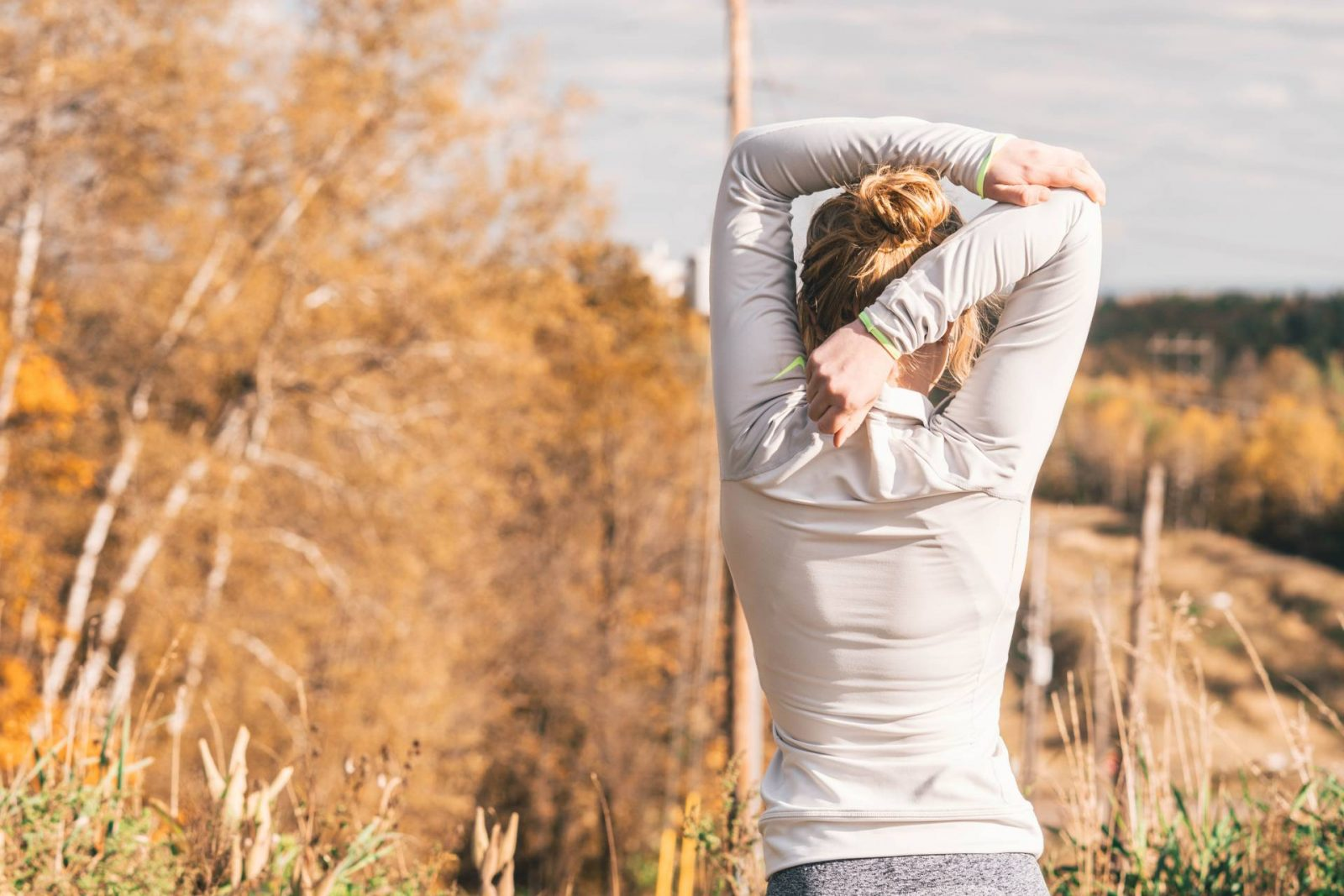 Tips for keeping fit in Winter, woman stretching triceps