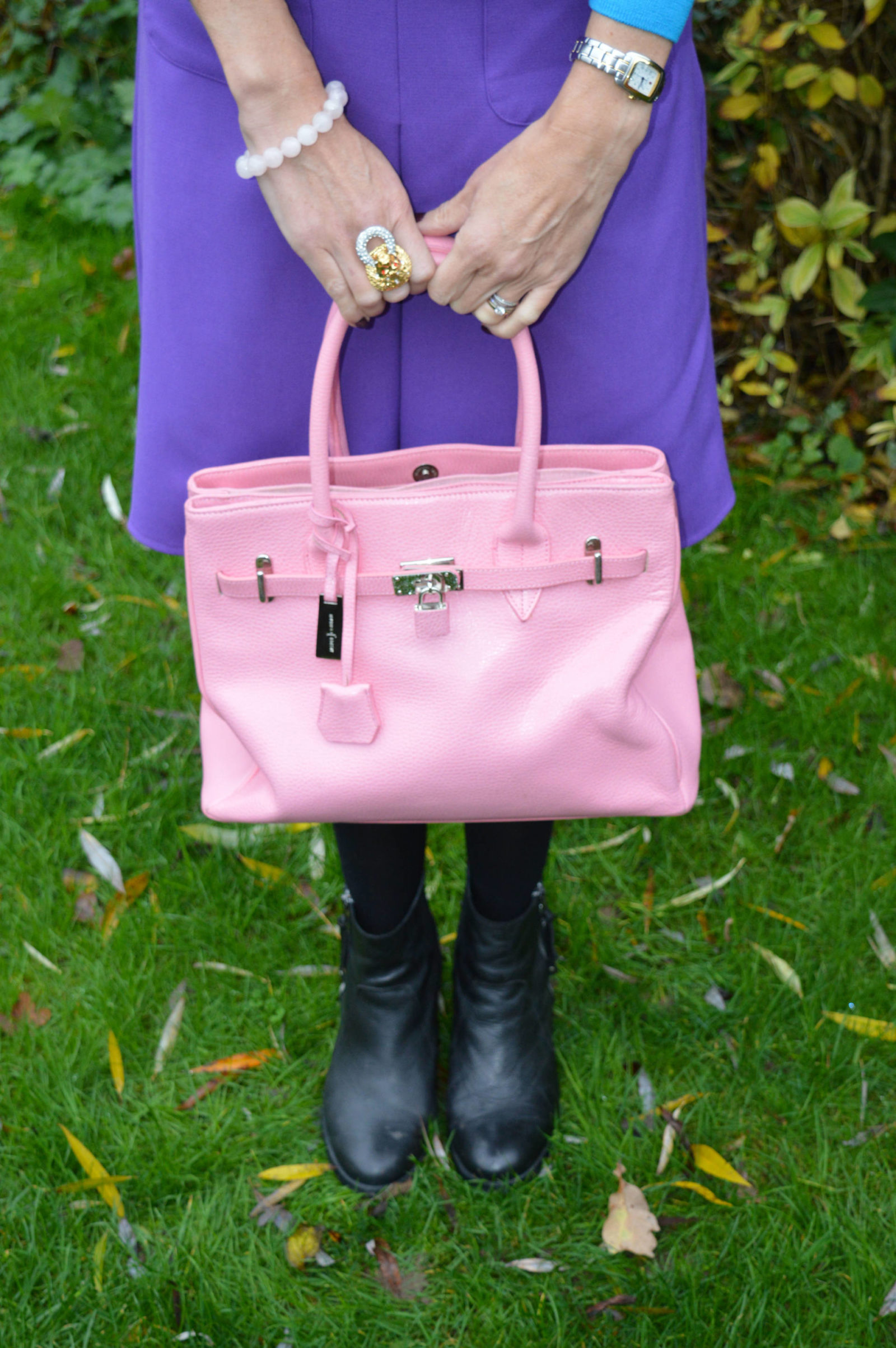 J by Jasper Conran pink bag, Kenneth Jay Lane lion doorknocker ring