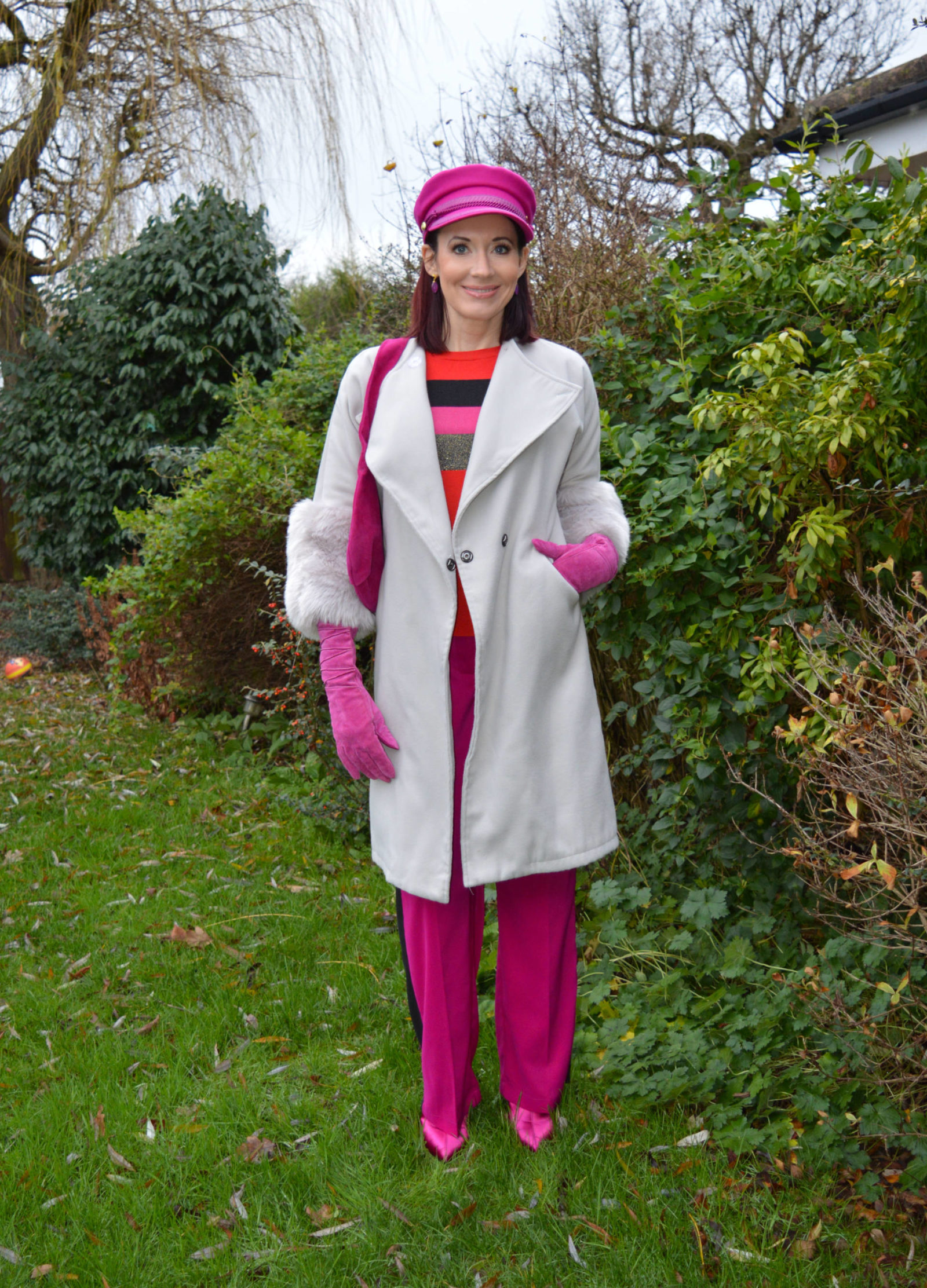 Fabienne Chapot pink hat and grey faux fur trim coat