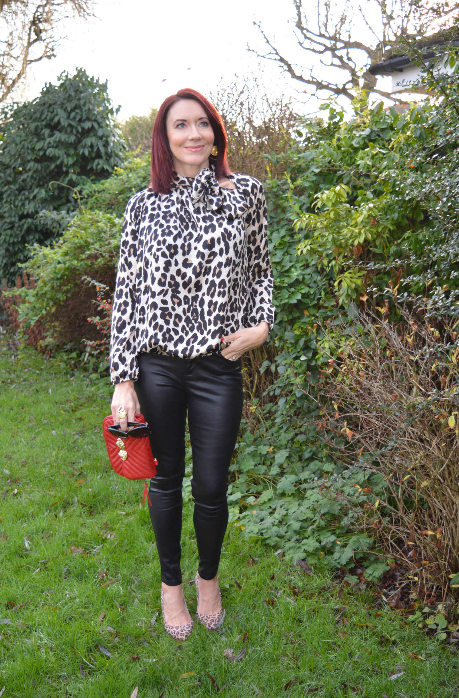 Leopard print pussy bow blouse and coated skinny jeans