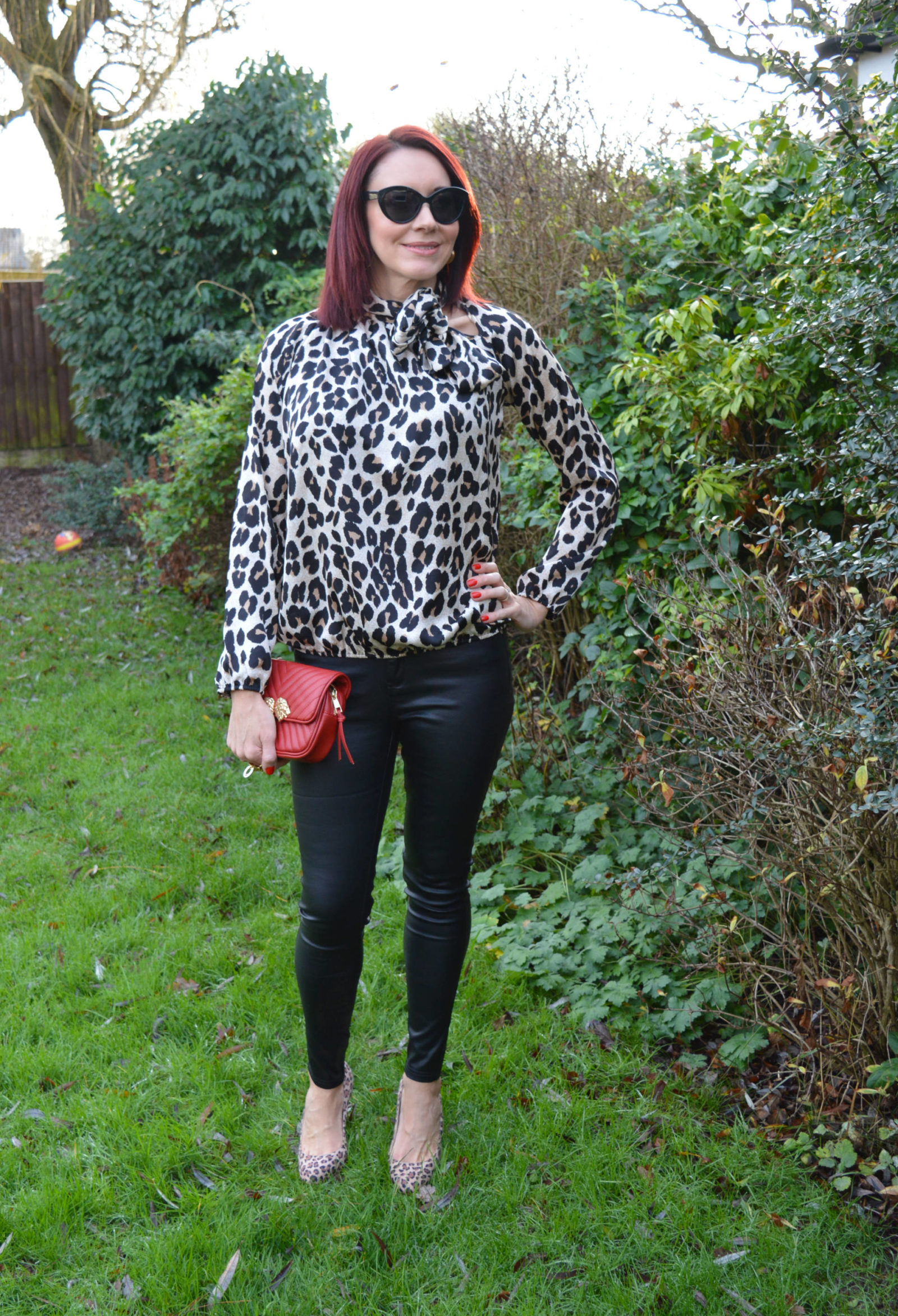 Leopard print pussy bow blouse and coated skinny jeans, Zara red multiway bag