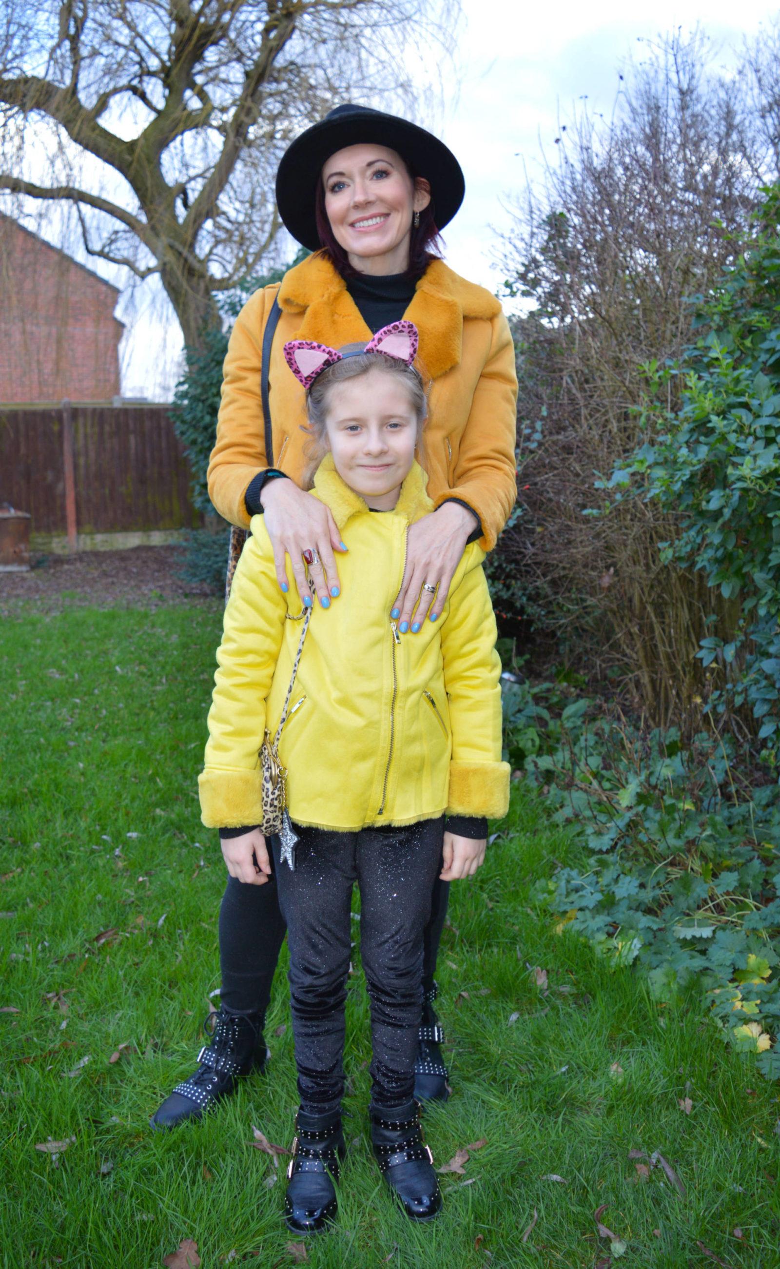 Matching yellow jackets, glitter trousers and biker boots