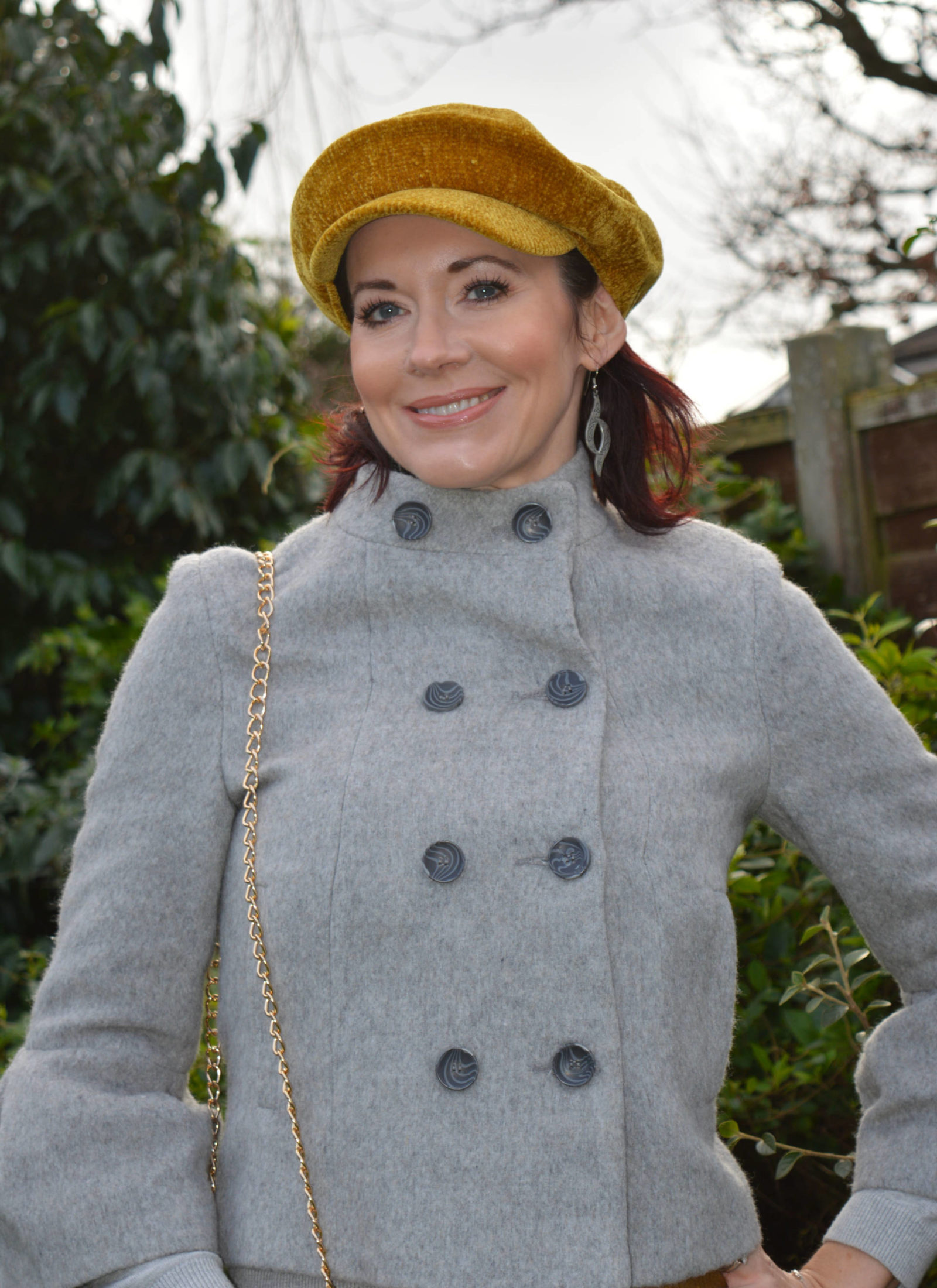 Mixing shades of grey and dark gold, grey Guray jacket, See by Chloe metallic skirt, ochre chenille cap