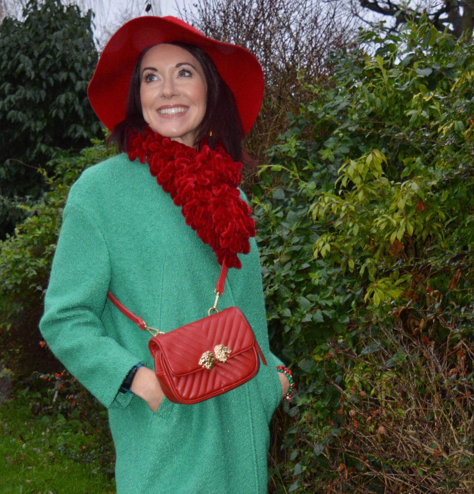 Bright green coat with red accessories Per Una green coat, Zara multiway bag