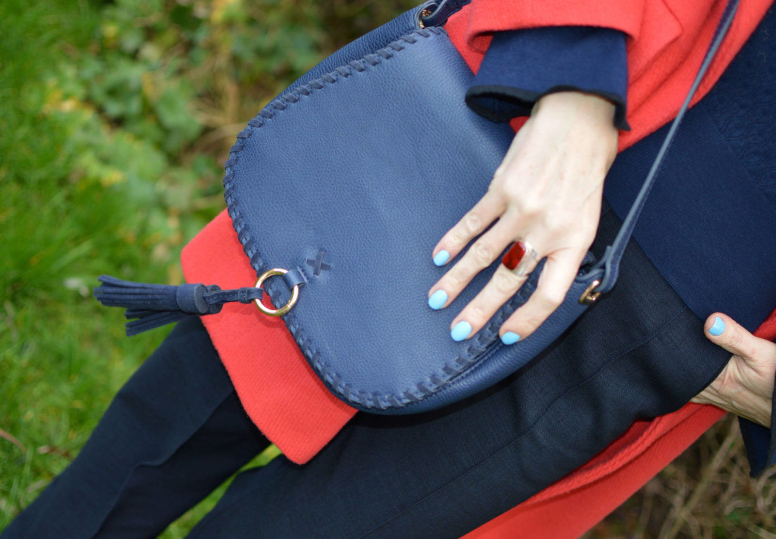 Classic navy trousers and sweater with a red coat, Laura Ashley navy tassel bag