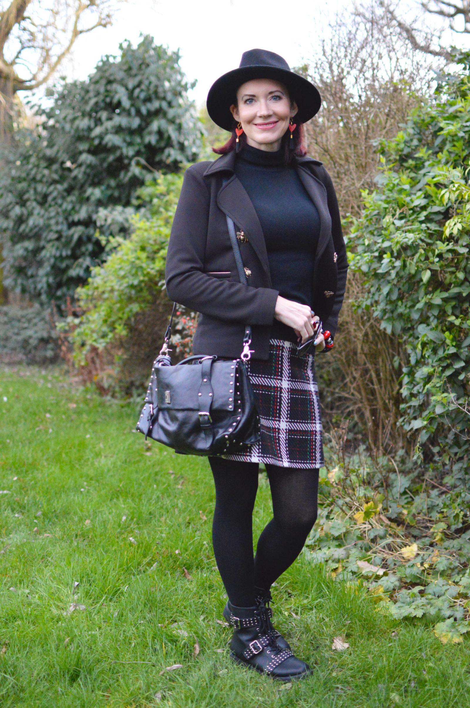 Check skirt and studded biker boots, Pom Amsterdam bugs jacket, Modalu studded satchel