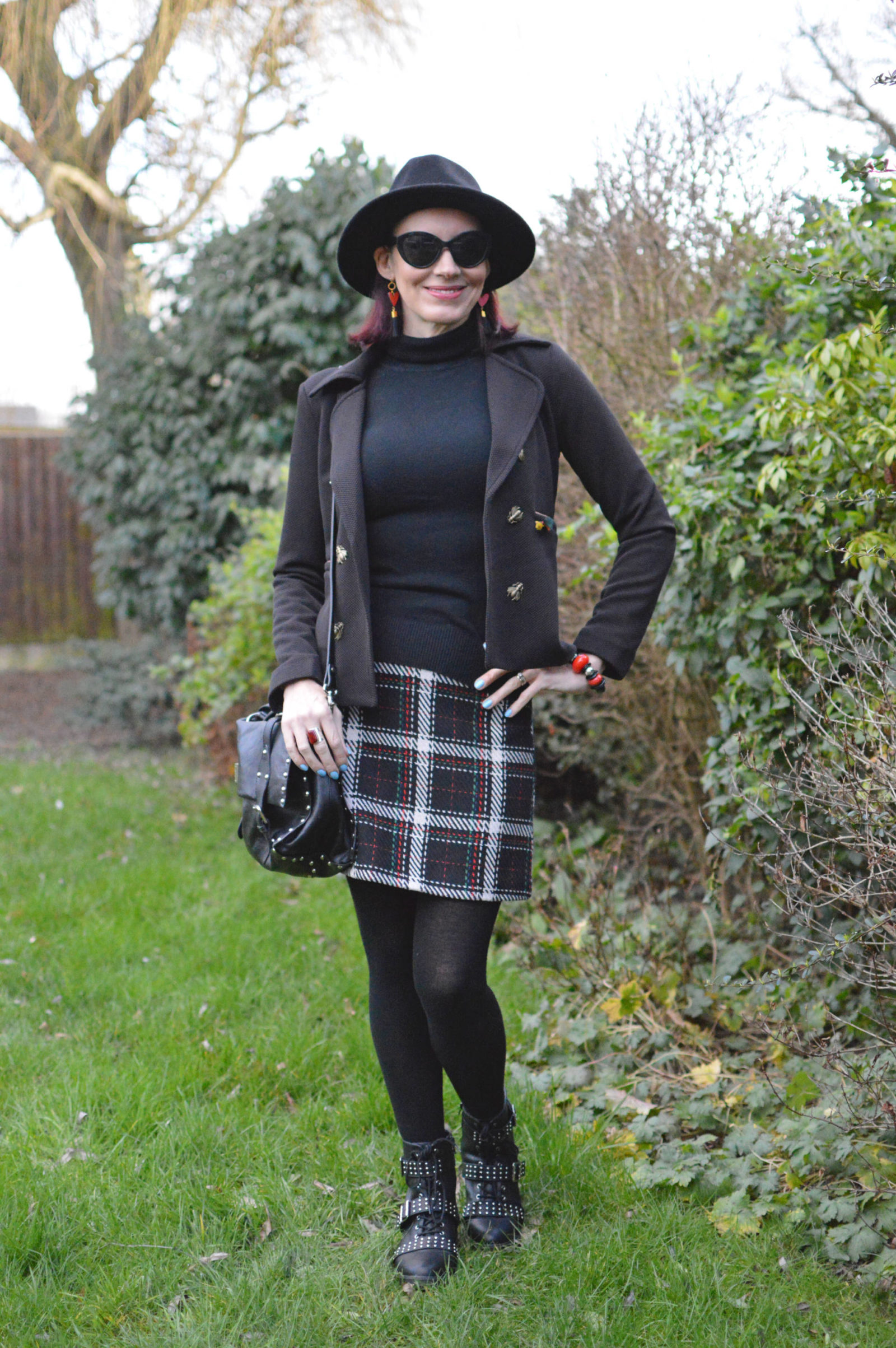 Check skirt and studded biker boots