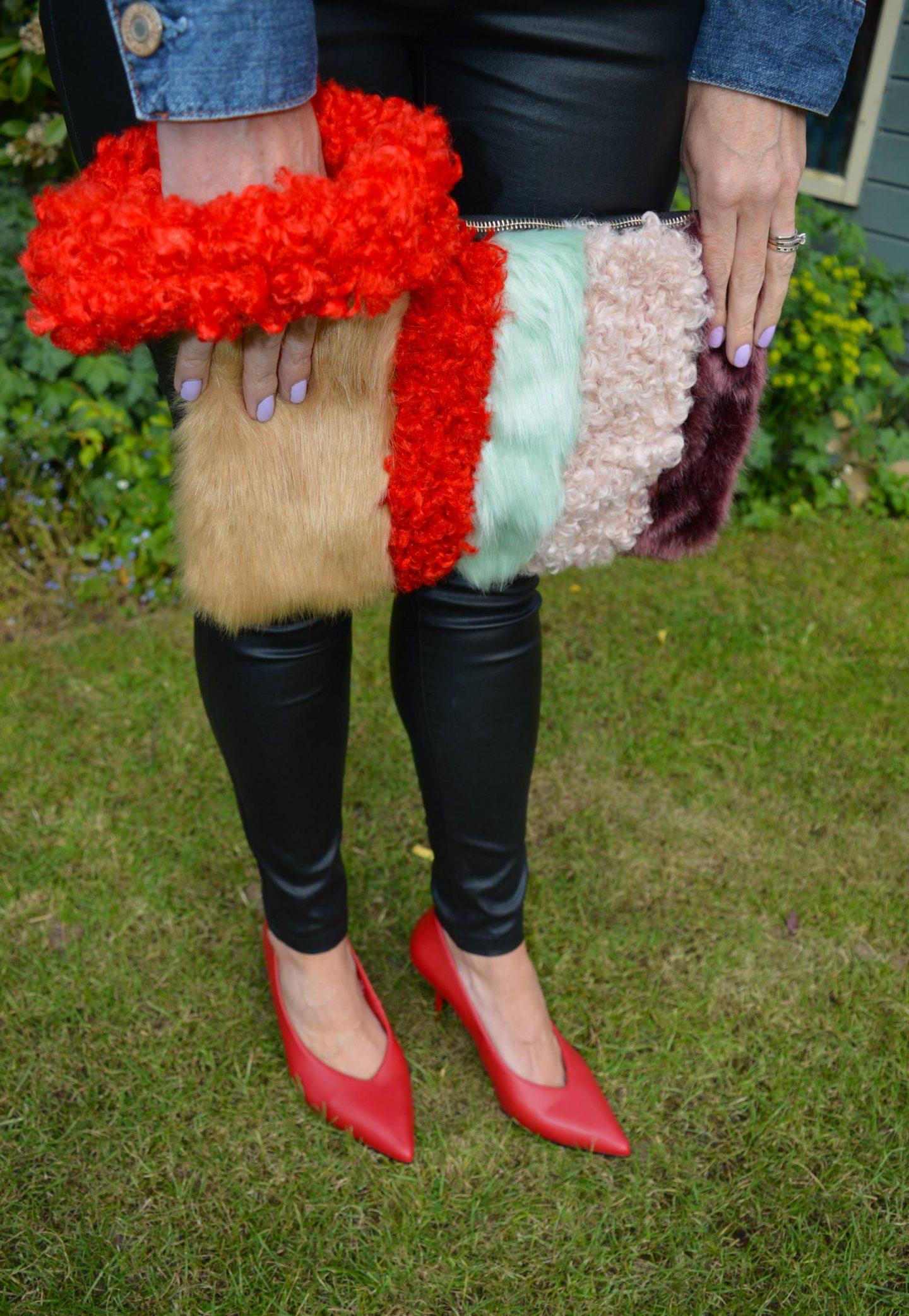 River Island faux fur striped clutch bag